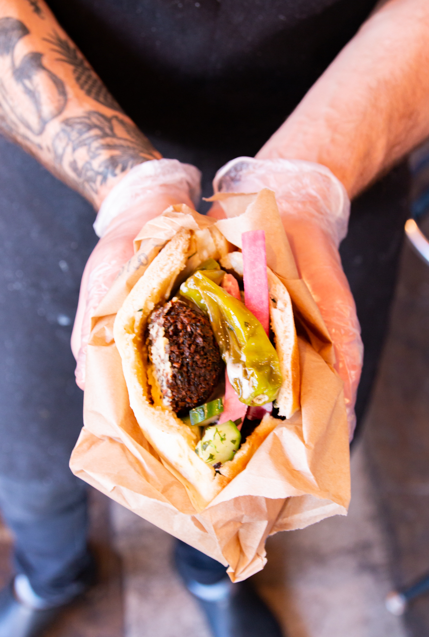 Fresh vegetarian falafel pita sandwich packed with all the Middle Eastern fixins. / Image: Elizabeth A. Lowry{ }// Published: 6.24.20
