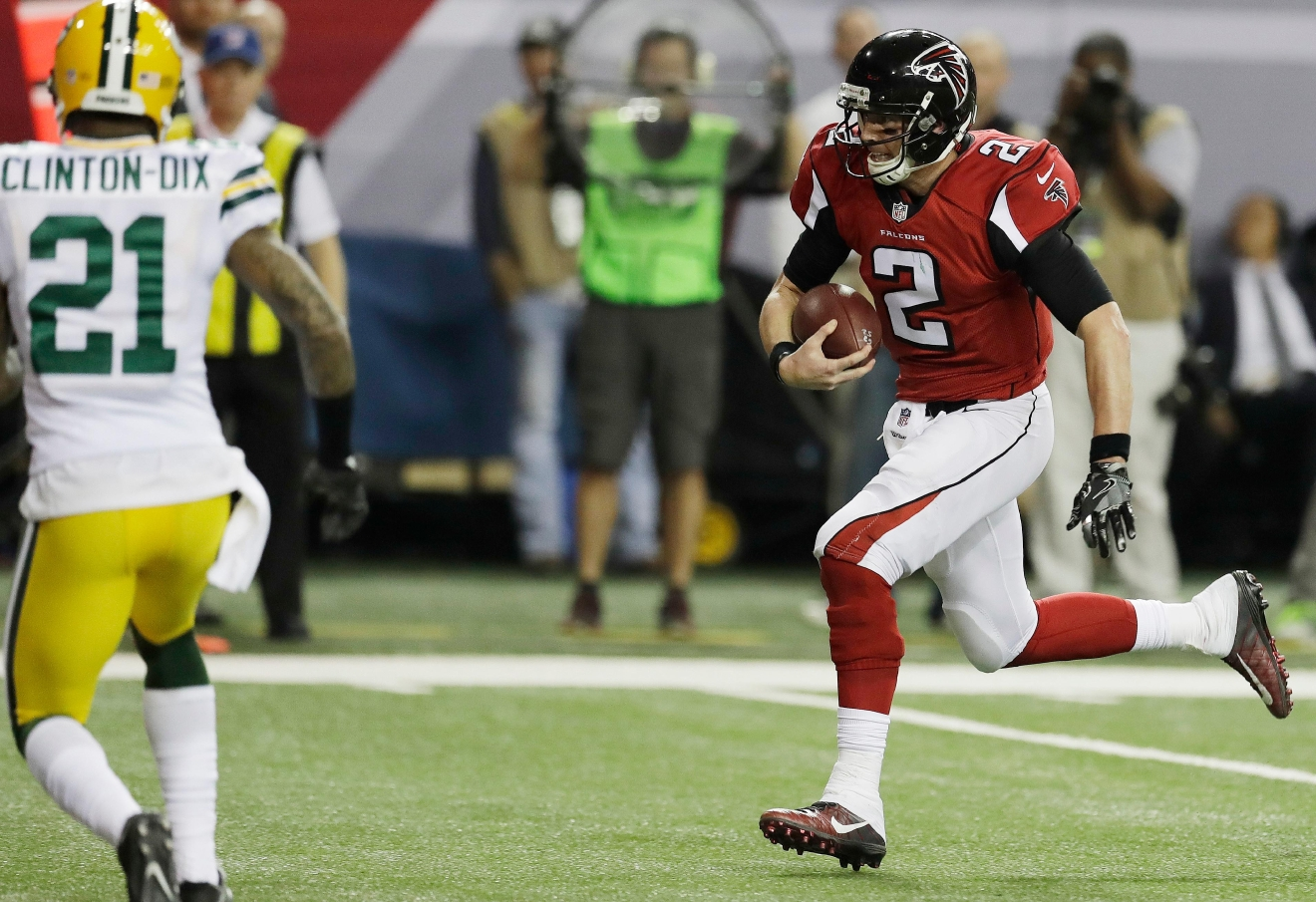 Atlanta Falcons' Matt Ryan runs for a touchdown during the first half of the NFC championship game against the Green Bay Packers Sunday, Jan. 22, 2017, in Atlanta. (AP Photo/David J. Phillip)