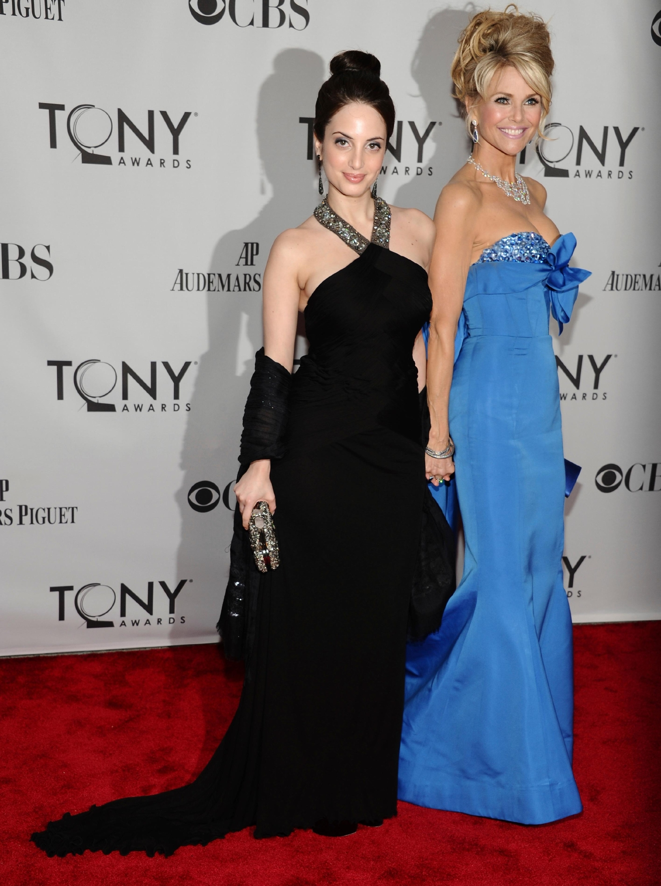 FILE - In this Sunday, June 12, 2011, file photo, Christie Brinkley, left, and her daughter Alexa Ray Joel arrive at the 65th annual Tony Awards, in New York. Christie Brinkley is returning to the pages of the Sports Illustrated Swimsuit issue at age 63 and this time she's also appearing with her two daughters. Brinkley will appear with her daughters, Joel and Sailor Brinkley Cook, in the issue coming out February 2017. (AP Photo/Charles Sykes, File)