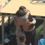 Airman surprises sister for Chiawana High School graduation