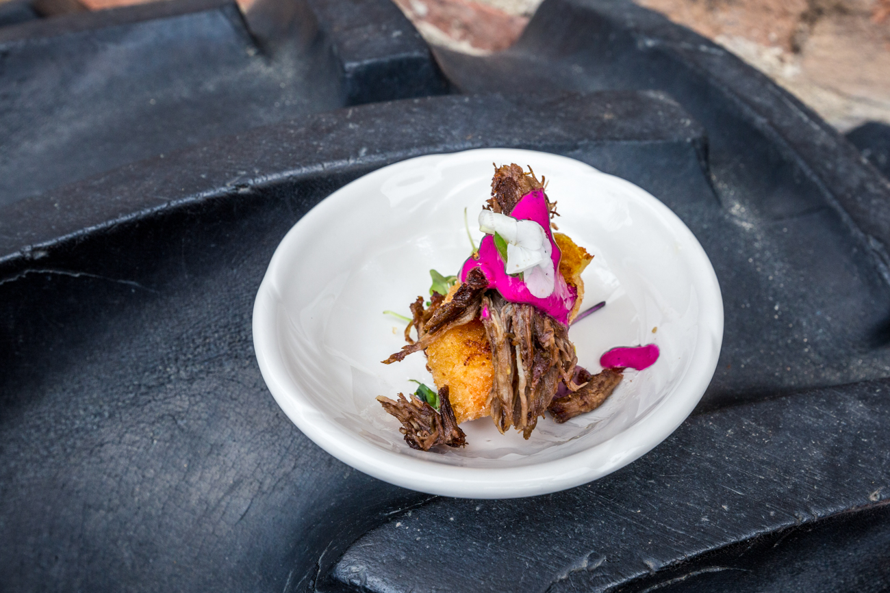 Clear Taco: beet whip mole, red chile relleno with lengua (beef tongue), rajas, micro cilantro, shoots, and micro lilies in a clear taco shell / Image: Catherine Viox{ }// Published: 6.18.19