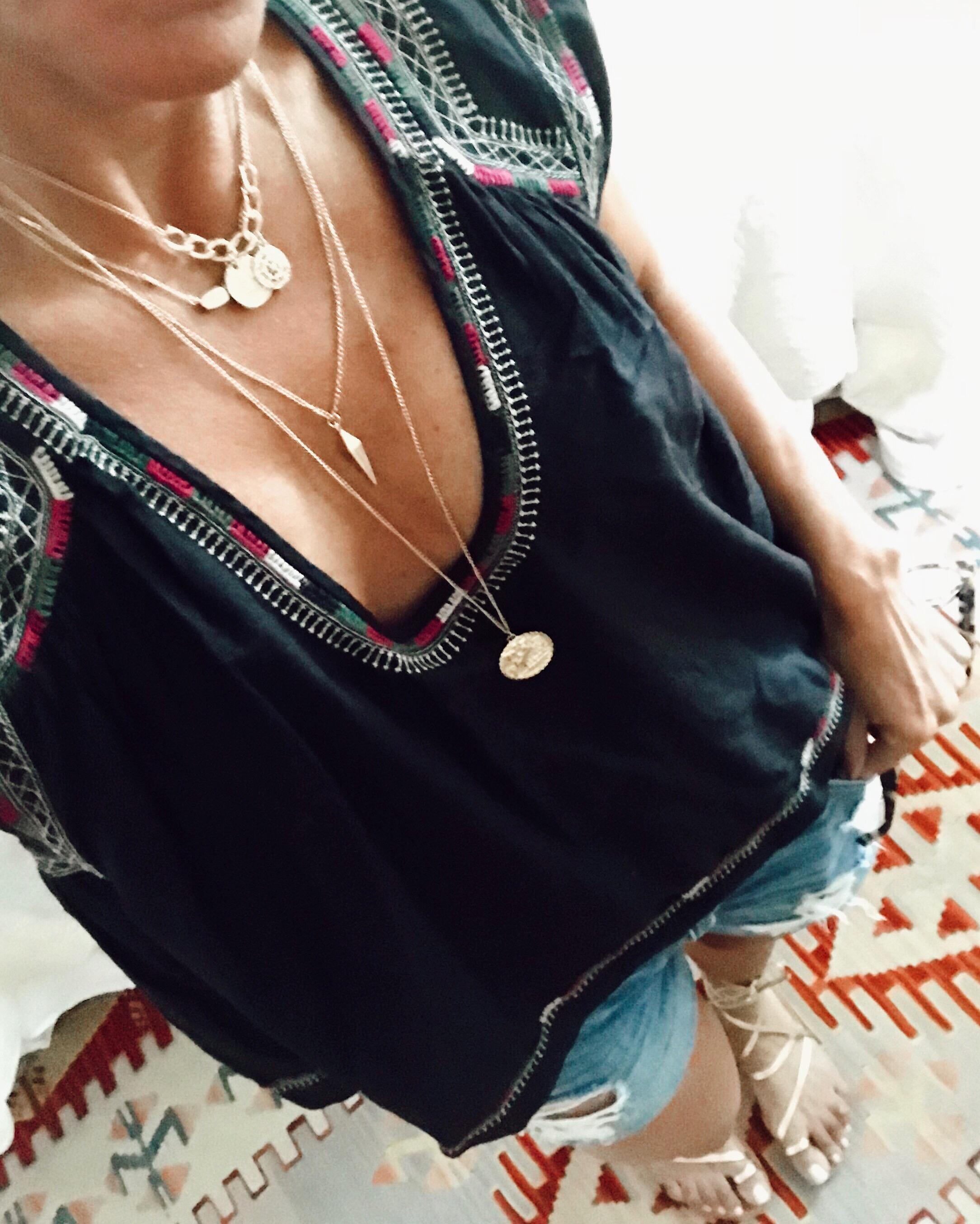 <p>&quot;Gold accessories, like this layered necklace and my favorite wrap-around sandals. They go with everything and add a subtle pop to any outfit.&quot;{&amp;nbsp;} (Image courtesy of Sylvia Colella, @simplysylvia, https://simplysylvia.com/)</p>