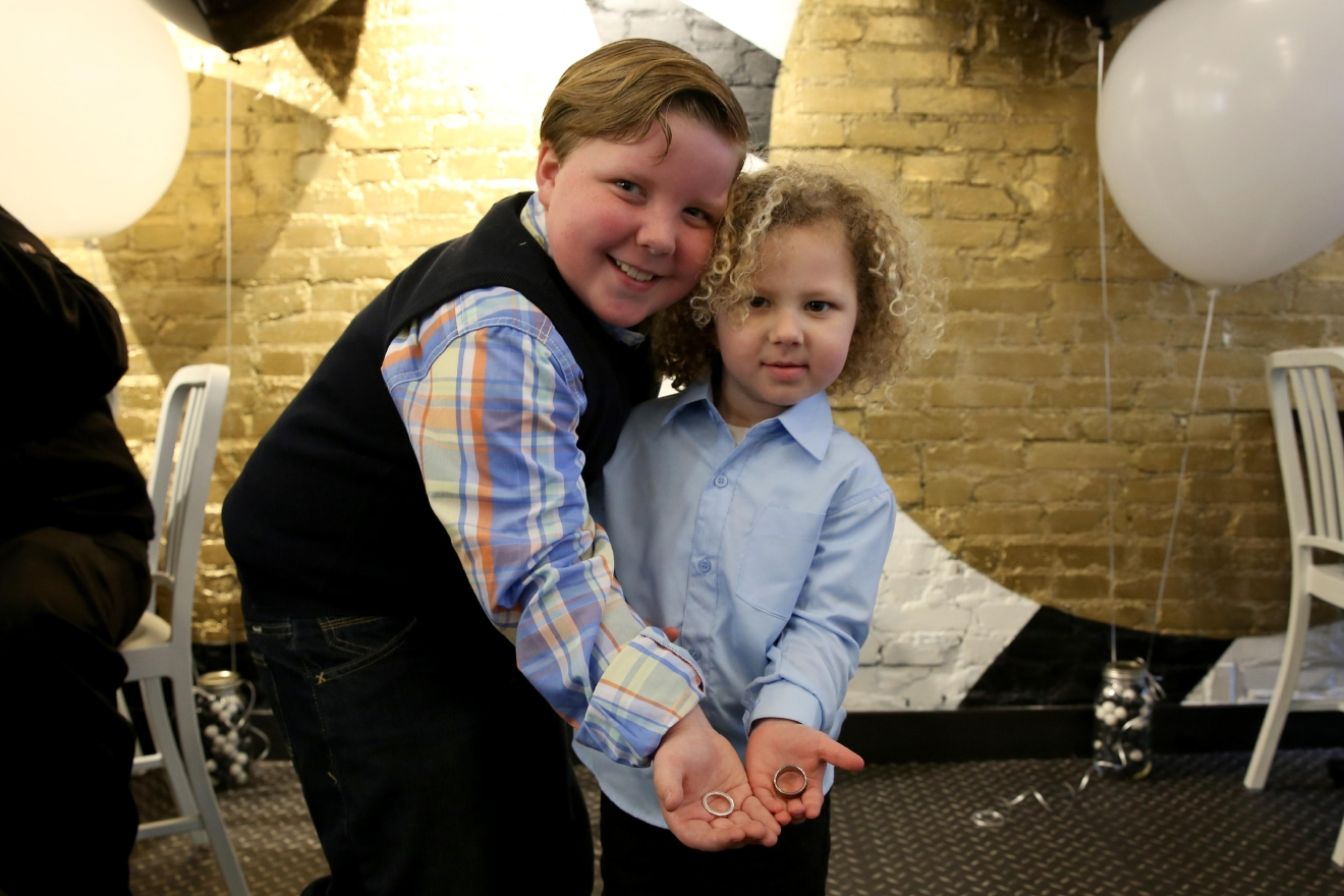 Jeffery, 8, and Mason, 3,  were ring-bearers for the ceremony. Their 3-month-old brother Justin snoozed through most of the wedding. (Amanda Andrade-Rhoades/DC Refined)