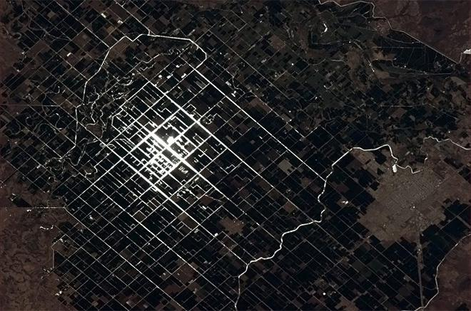 Sunglint catches the irrigation canals of these Mexican farmers.  (Photo & Caption: Chris Hadfield/NASA)