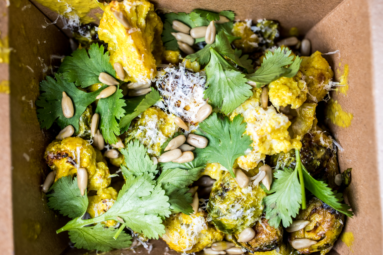 Roasted Brussels sprouts & cauliflower: curry, cilantro, parmesan, and sunflower seeds / Image: Catherine Viox{ }// Published: 5.31.20