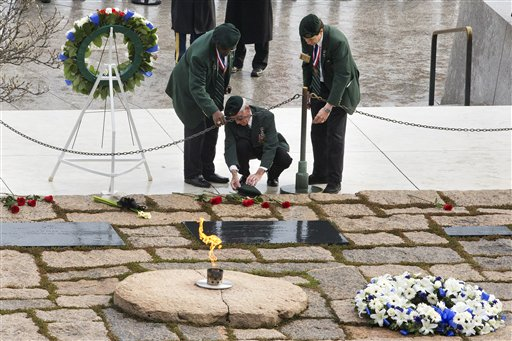 Wallace Johnson, 74, of Dumfries, Va., and two fellow green berets lay a beret at the gravesite of President John F. Kennedy.