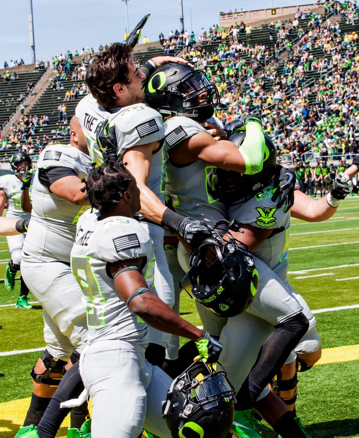 A group of Team Free players celebrate a touchdown by Team Free wide reciever Darren Carrington (#22). The 2017 Oregon Ducks Spring Game provided fans their first glimpse at the team under new Head Coach Willie Taggart's direction. Team Free defeated Team Brave 34-11 on a sunny dat at Autzen Stadium in Eugene, Oregon. Photo by Ben Lonergan, Oregon News Lab
