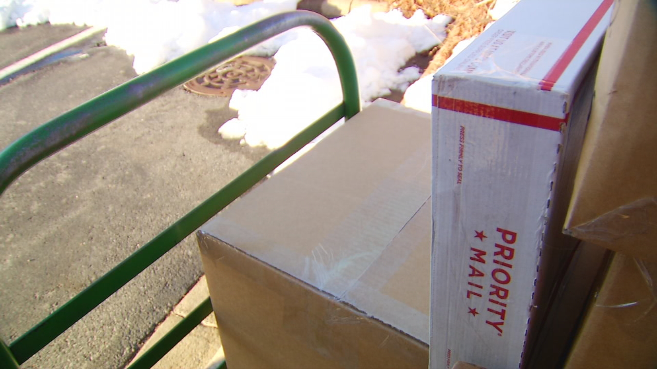Snow and ice caused disruptions during the busy holiday shipping season, with companies like UPS suspending deliveries in cities such as Asheville on Saturday. (Photo credit: WLOS staff)