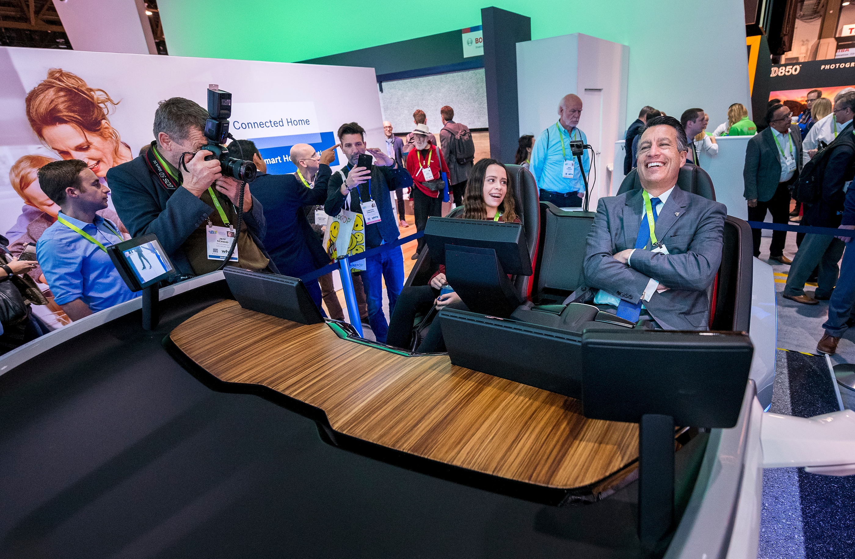 "Nevada Governor Brian Sandoval, right, ""relaxes"" behind the wheel of an autonomous car demonstration as his daughter Marisa Sandoval looks on from the passenger seat during a tour of the Bosch booth at CES in the Las Vegas Convention Center on Thursday, Jan. 11, 2018. CREDIT: Mark Damon/Las Vegas News Bureau"