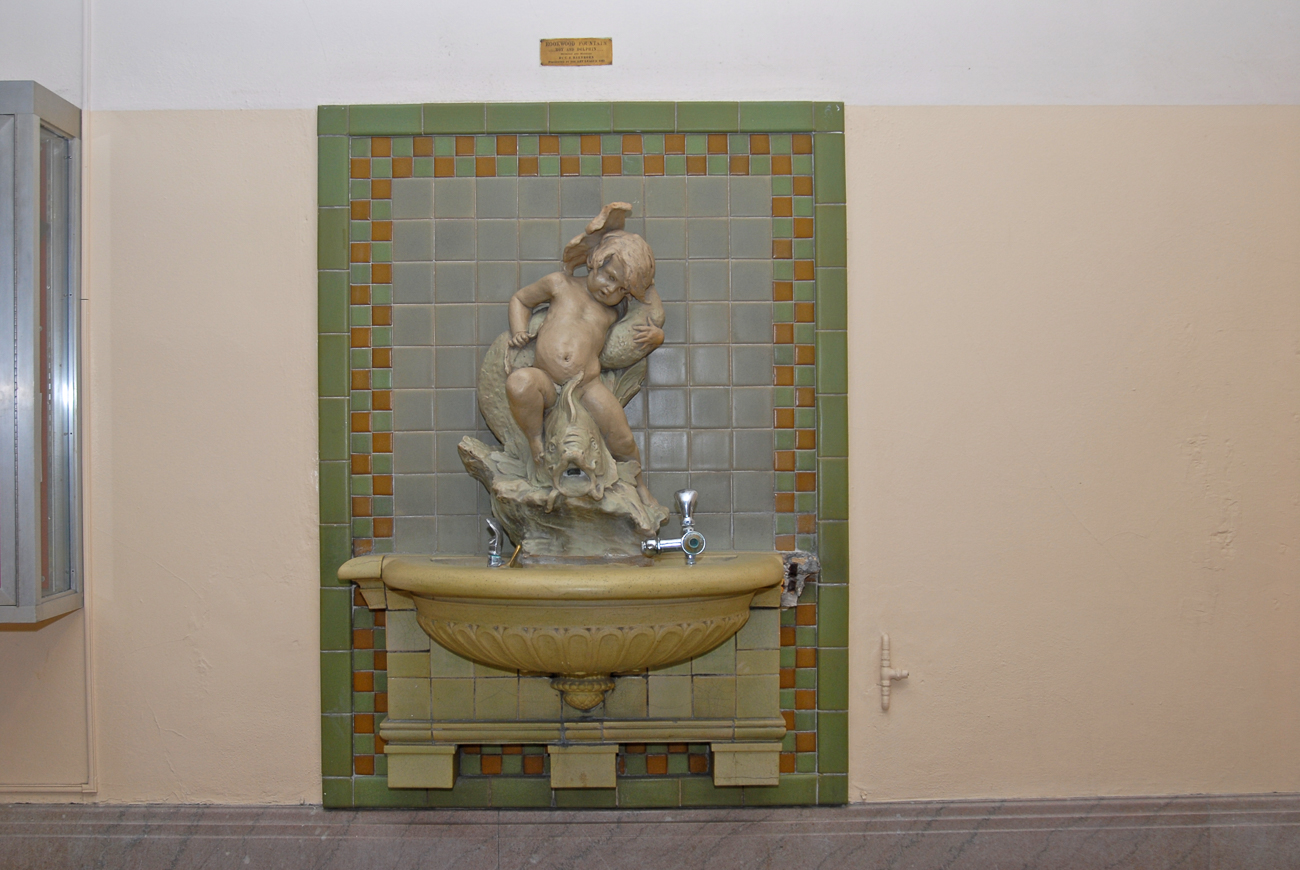 A fountain depicting a boy and a dolphin that was designed by Clement J. Barnhorn and  donated by the Art League in 1912. It is located on the first floor in the east (main) corridor, north of the main entrance. / Image and research by Tim Jeffries // Published: 4.28.19