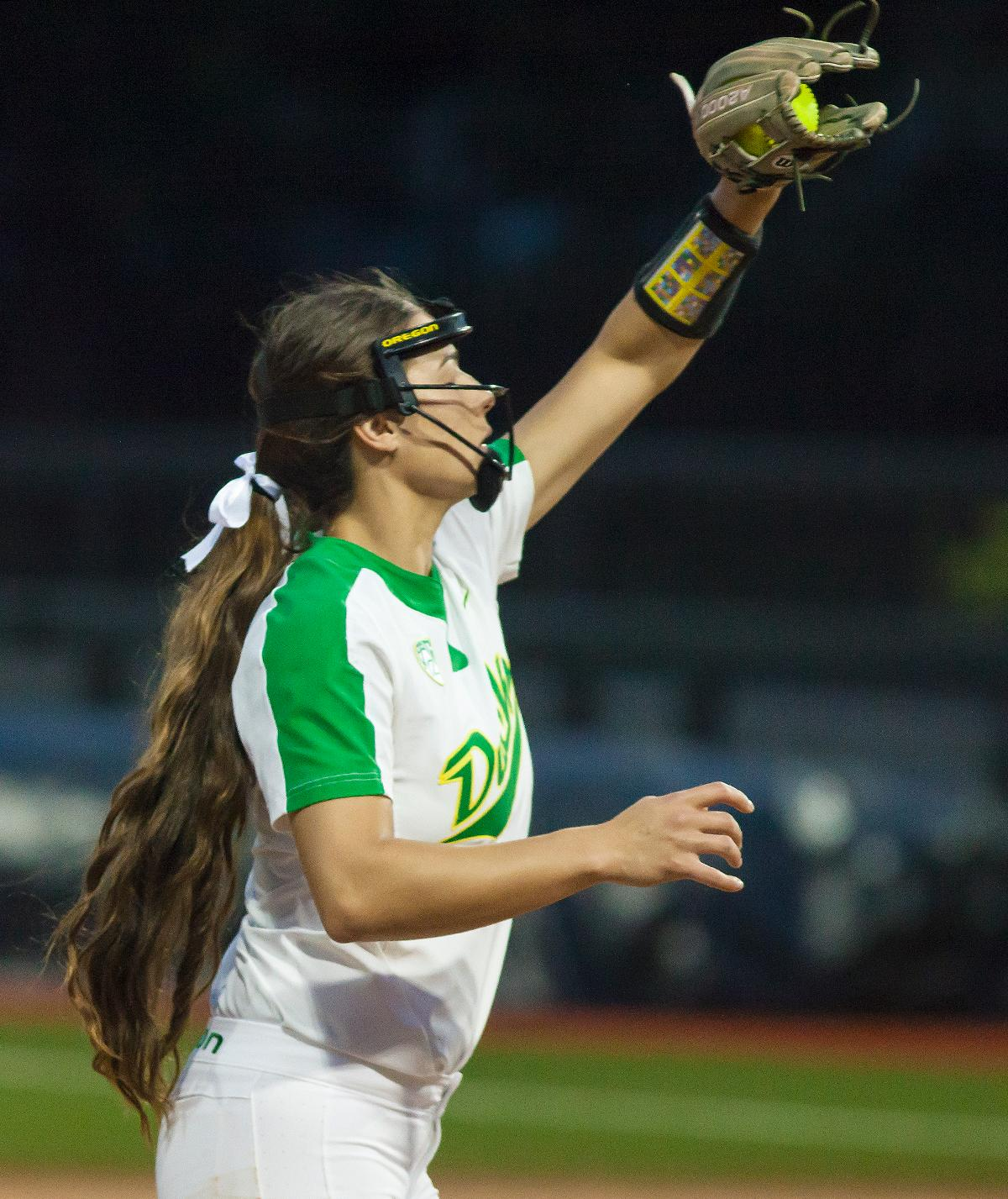 Oregon utility player Nikki Udria (#3) catches the ball near the third baseline. In the first of a three game series the Oregon Ducks defeated the California Golden Bears five to one. Photo by Ben Lonergan, Oregon News Lab