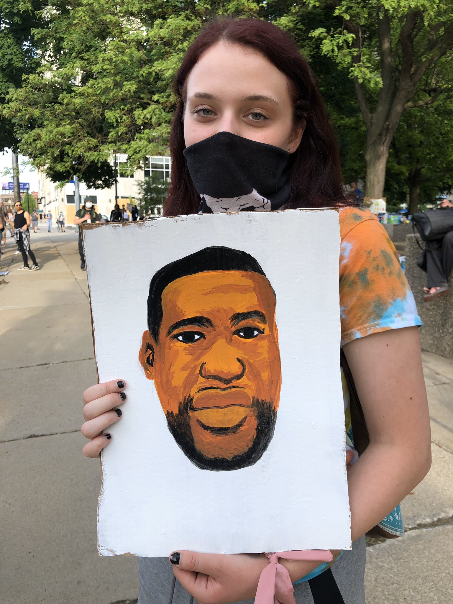 Jackie Burch ,23, holds a painting of George Floyd in Kalamazoo during the protest in front of the Kalamazoo County Courthouse June 3, 2020. (WWMT/Genevieve Grippo)