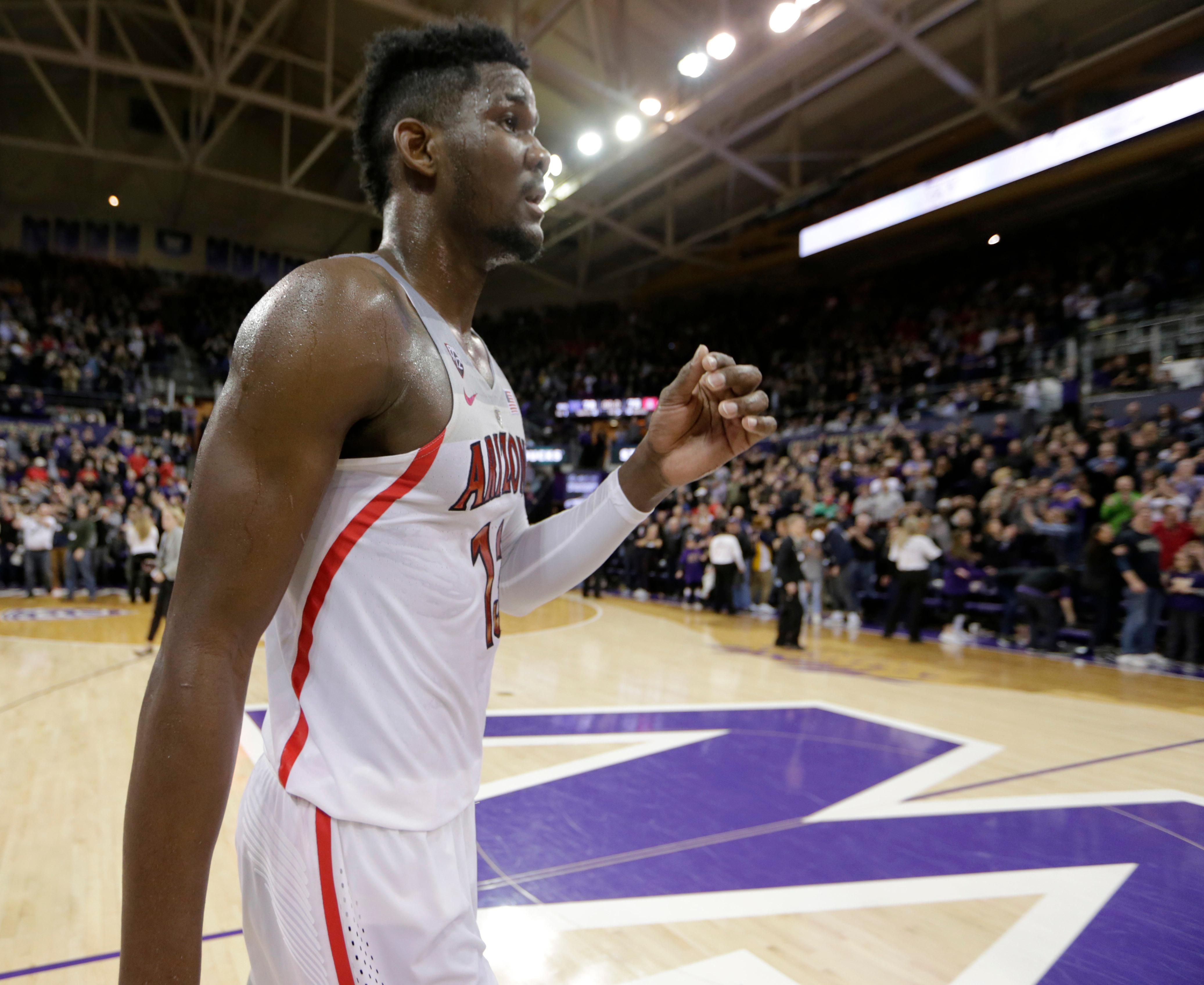 Arizona's Deandre Ayton walks off the court after the team's 78-75 loss to Washington in an NCAA college basketball game Saturday, Feb. 3, 2018, in Seattle. (AP Photo/John Froschauer)