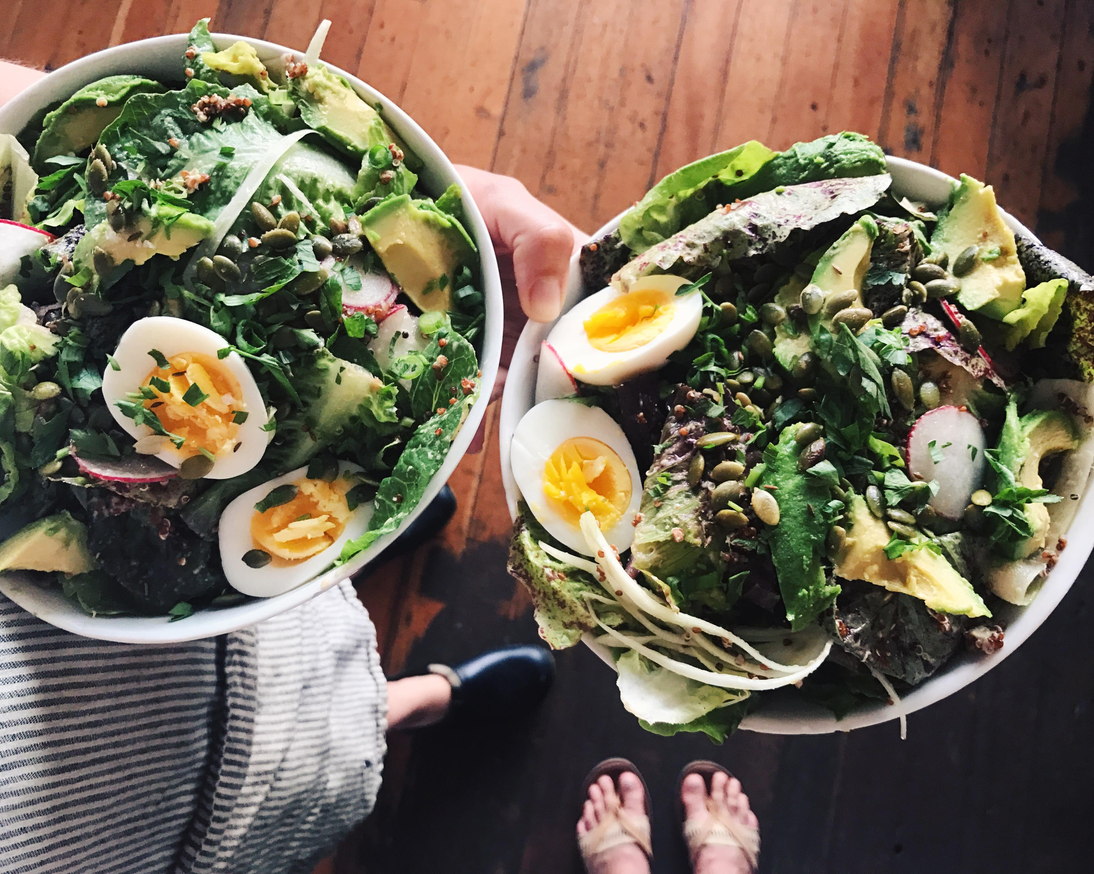 Juicebox's Quinoa Greens Salad; quinoa, cilantro, baby lettuces, radish, shaved fennel, avocado, cumin, and pepitas with roasted fennel vinaigrette and soft-cooked eggs. Totally gluten-free. (Image: Kari Brunson)