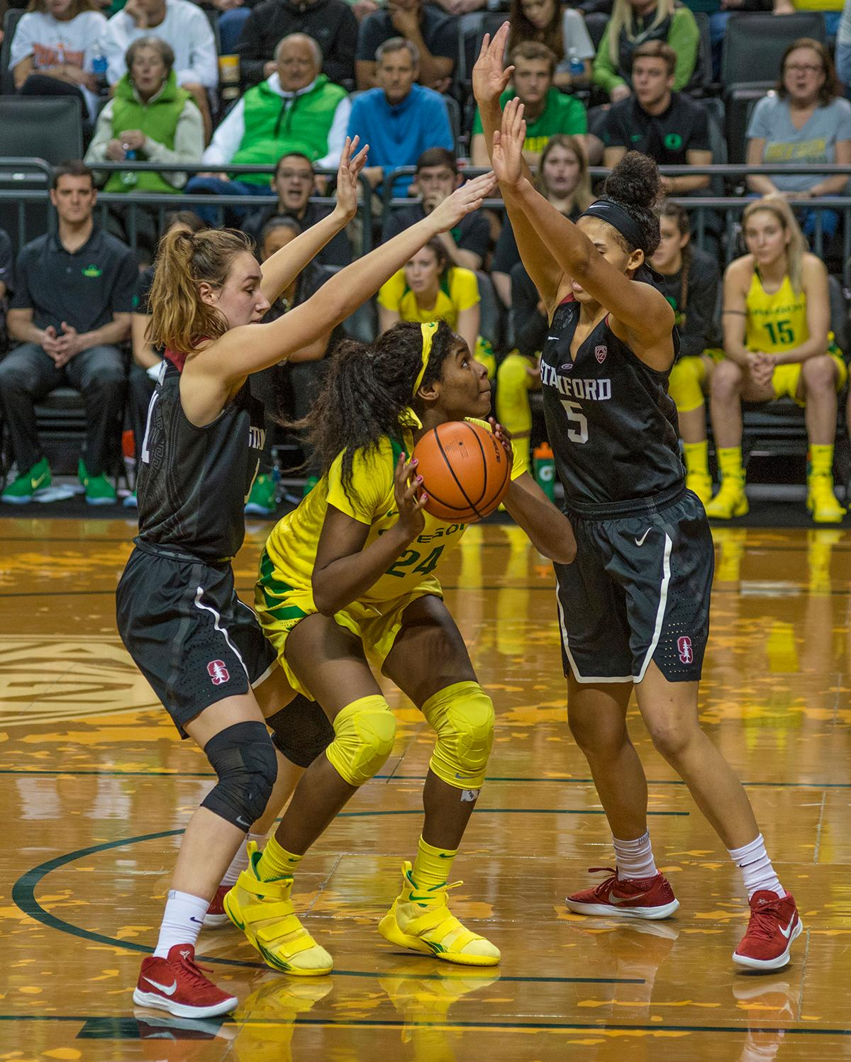 Oregon Ducks Ruthy Hebard (#24) looks for a shot. The Stanford Cardinal defeated the Oregon Ducks 78-65 on Sunday afternoon at Matthew Knight Arena. Stanford is now 10-2 in conference play and with this loss the Ducks drop to 10-2. Leading the Stanford Cardinal was Brittany McPhee with 33 points, Alanna Smith with 14 points, and Kiana Williams with 14 points. For the Ducks Sabrina Ionescu led with 22 points, Ruthy Hebard added 16 points, and Satou Sabally put in 14 points. Photo by Dan Morrison, Oregon News Lab