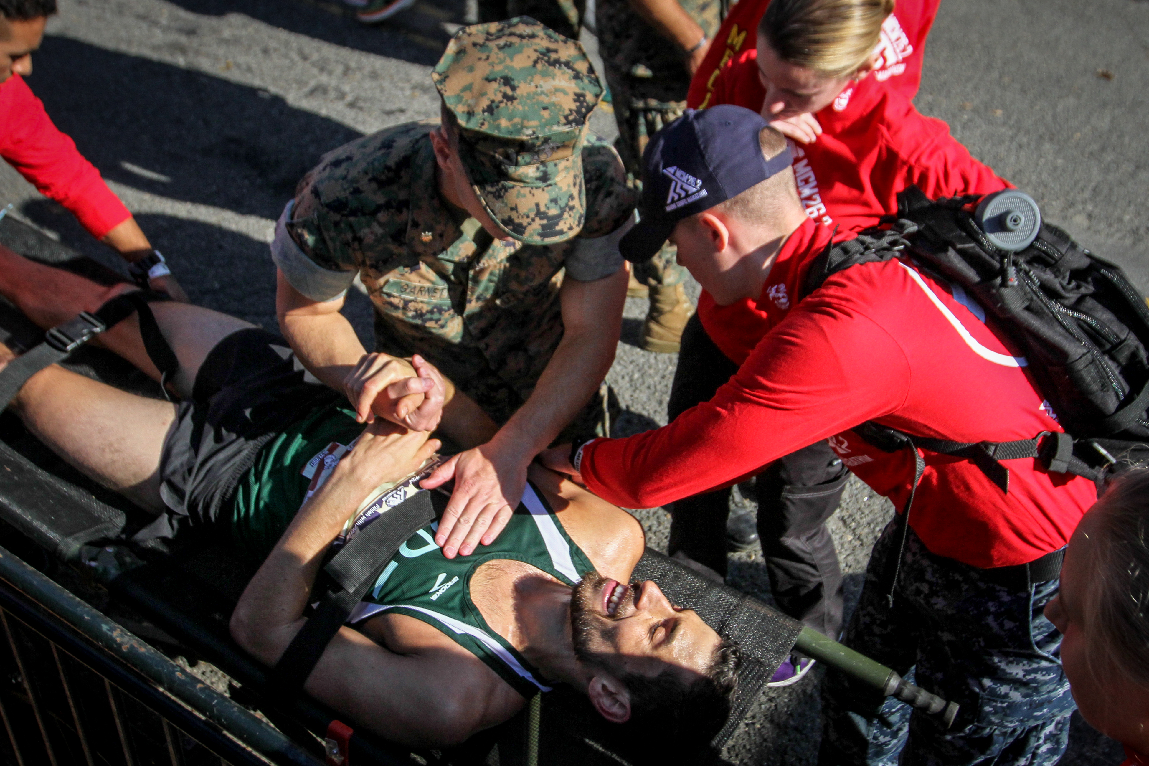 November, 2017. A runner is comforted after collapsing near the finish line of the Marine Corps Marathon.{&amp;nbsp;} (Amanda Andrade-Rhoades/DC Refined)<p></p>
