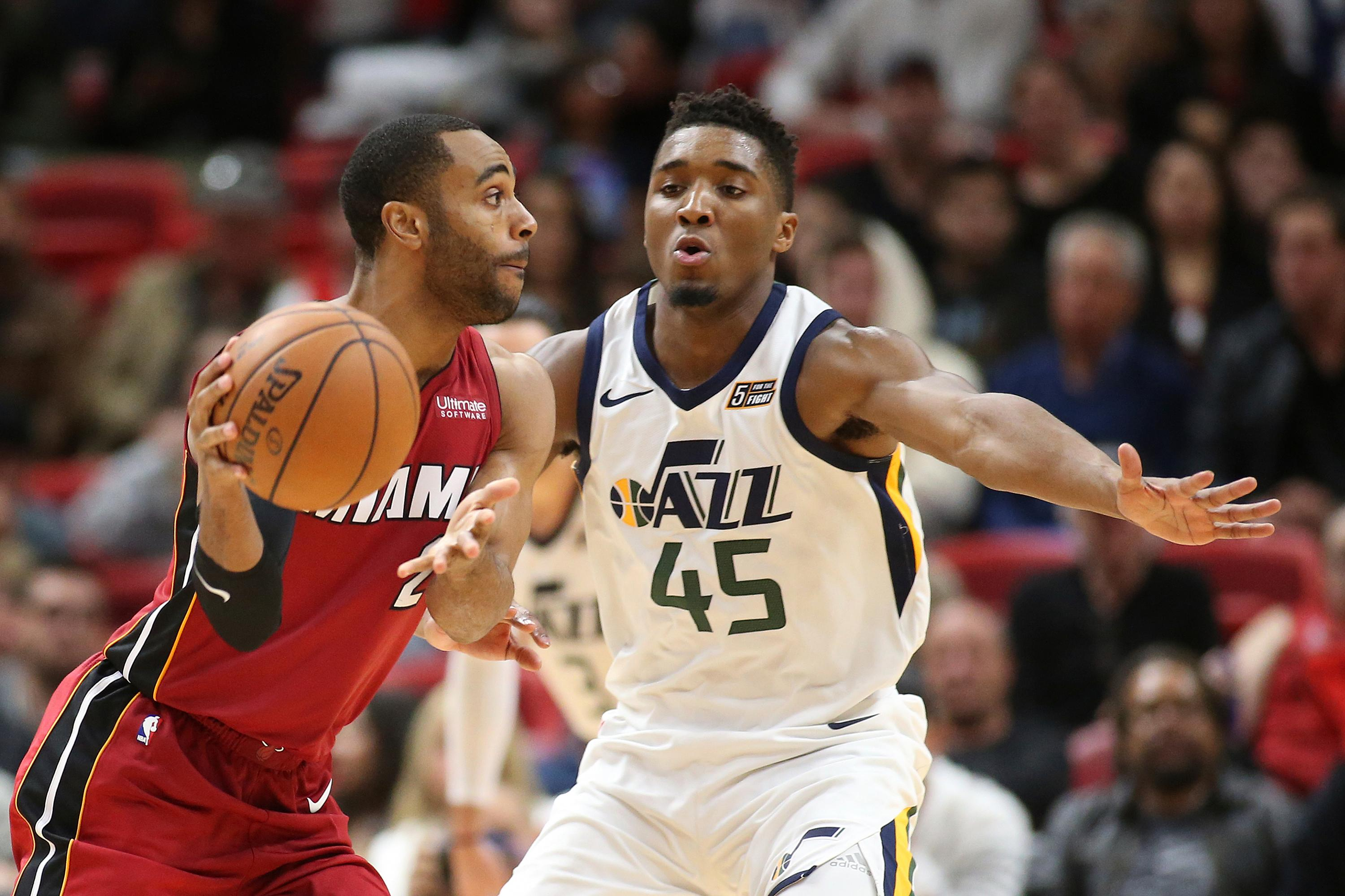 Utah Jazz guard Donovan Mitchell (45) defends against Miami Heat guard Wayne Ellington (2) during the second half of an NBA basketball game, Sunday, Jan. 7, 2018, in Miami. (AP Photo/Joel Auerbach)