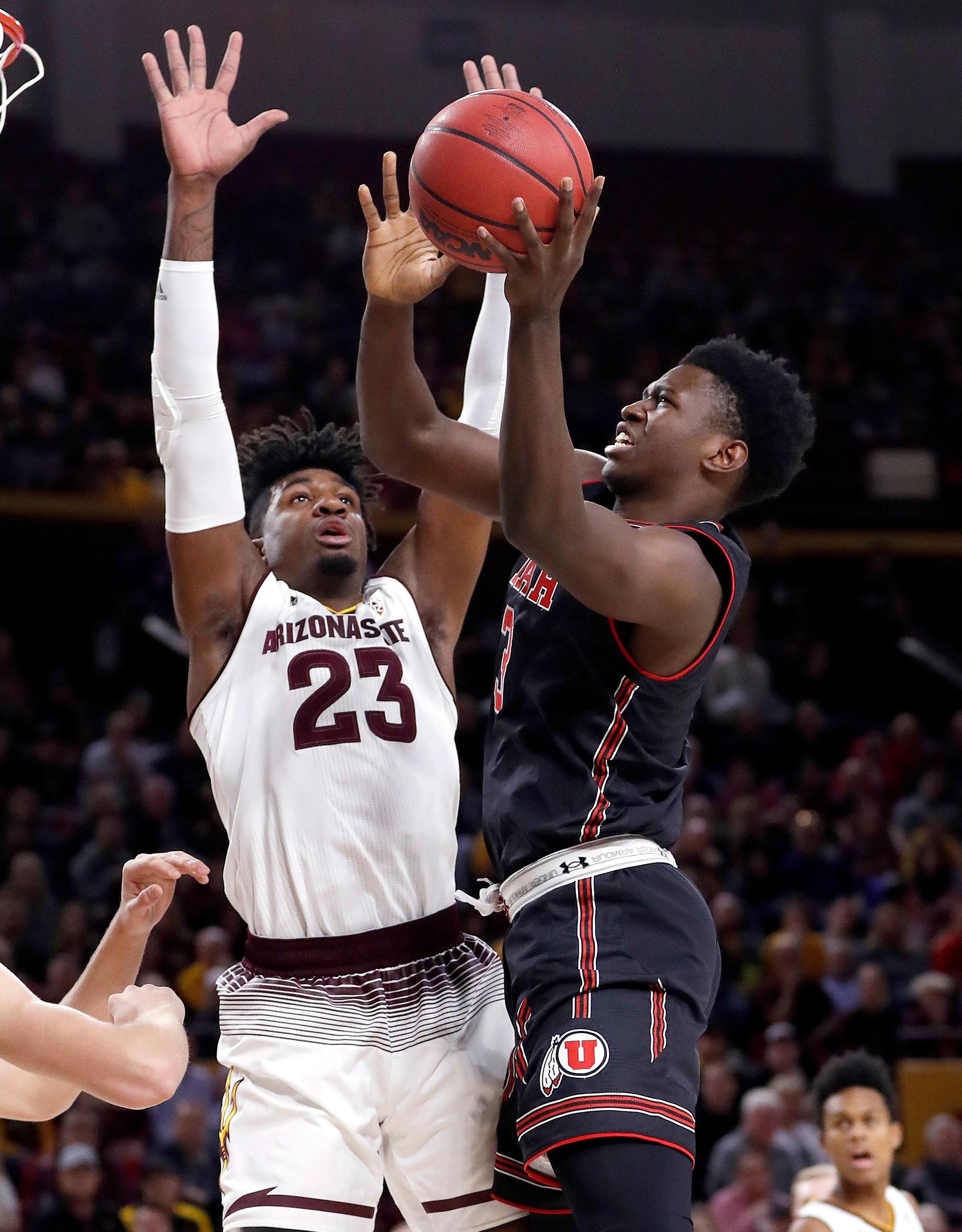 Utah forward Donnie Tillman (3) shoots over Arizona State forward Romello White (23) during the first half of an NCAA college basketball game, Thursday, Jan. 25, 2018,in Tempe, Ariz. (AP Photo/Matt York)