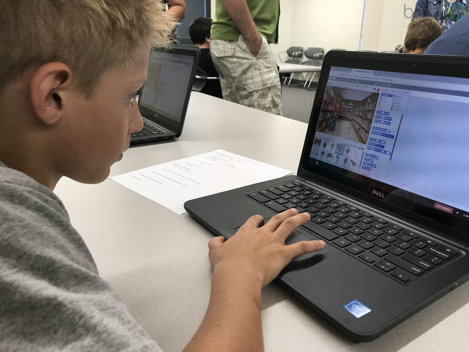 "Getting kids to talk tech was the goal of the ""Fun with Coding"" session that took place Saturday morning at the Butman-Fish Library in Saginaw. (Photo Credit: Jasmyn Durham)"