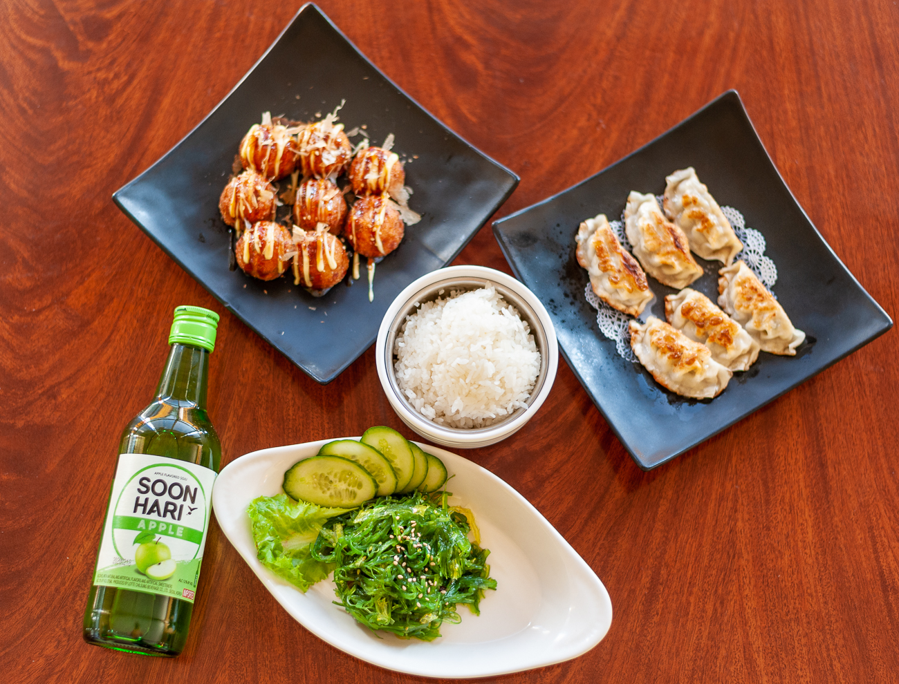 Seaweed Salad, Rice Bowl, Gyoza, and Takoyaki with apple drink / Image: Kellie Coleman // Published: 12.29.20
