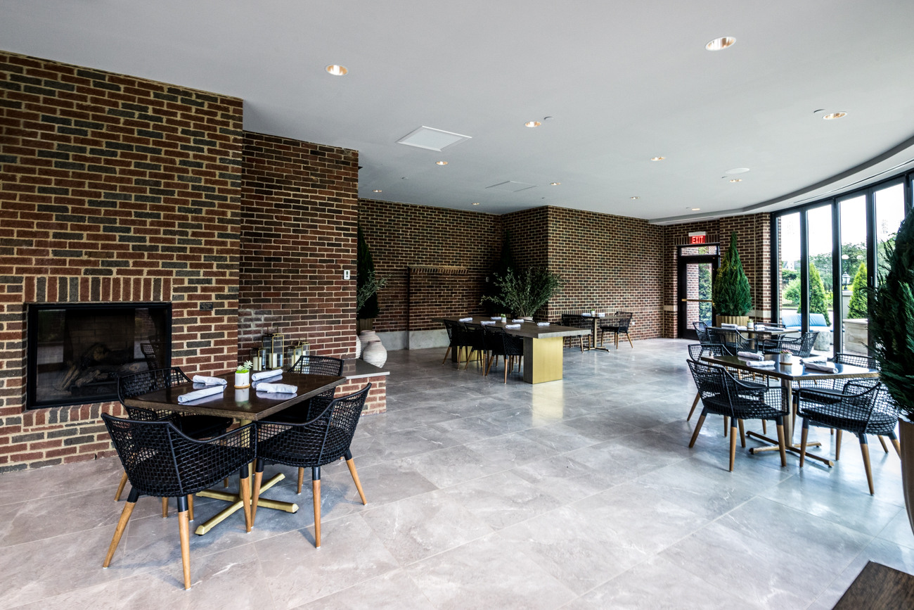 "The restaurant boasts a ""bring the outside in"" aesthetic with large plants and plant-themed wall designs that decorate the space, as well as a massive skylight above the bar. Beyond the bar area is a large dining room, a private dining room, an all-seasons dining room with retractable windows, in addition to an al fresco patio. / Image: Catherine Viox // Published: 6.22.20"