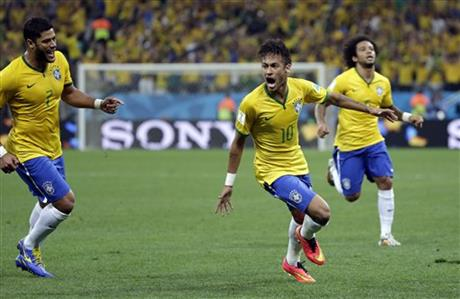 Brazil's Neymar, centre, celebrates after scoring his sides first goal during the group A World Cup soccer match between Brazil and Croatia, the opening game of the tournament, in the Itaquerao Stadium in Sao Paulo, Brazil, Thursday, June 12, 2014.