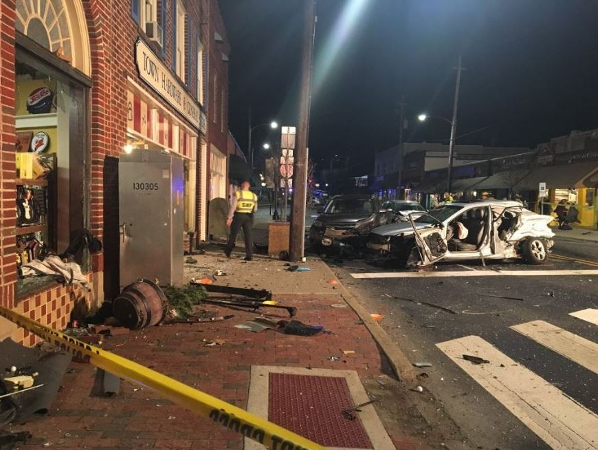 A collision involving at least four vehicles on State Street in downtown Black Mountain injured several people and caused heavy damage to Town Hardware. (Photo credit: WLOS staff)