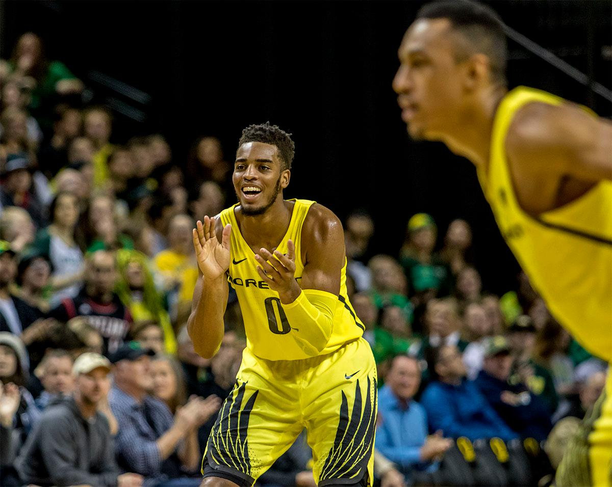 The Duck's Troy Brown Jr. (#0) cheers on his teammate steal and basket. The UO Ducks basketball team suffered a loss to the USC Trojans, 75-70, at Matthew Knight Arena on Thursday. Payton Pritchard lead the scoring with 18 points. The Ducks are now 2-4 in conference play and 12-7 overall. The Ducks will next play the UCLA at Matthew Knight Arena at 7:15 p.m. on Saturday, Jan. 20. Photo by August Frank, Oregon News Lab