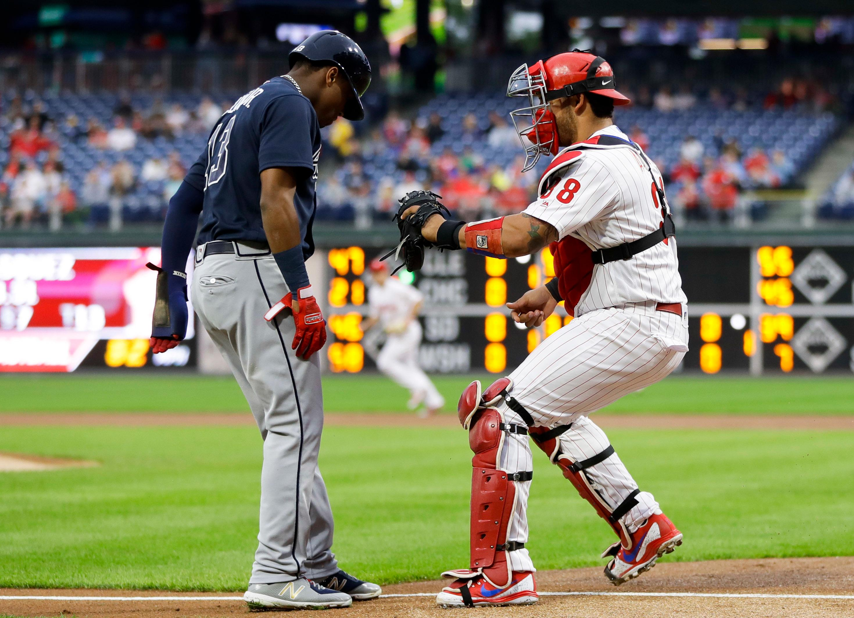 Philadelphia Phillies catcher Jorge Alfaro, right, tags out Atlanta Braves' Ronald Acuna Jr. after Acuna tried to score on a single by Nick Markakis during the first inning of a baseball game, Tuesday, May 22, 2018, in Philadelphia. (AP Photo/Matt Slocum)