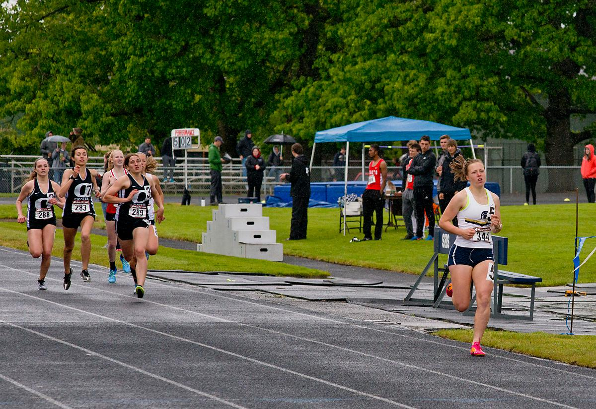 Rainy Adkins from Marist wins the 800 meter run with a time of 2:23.74 at the 5A-3 Midwestern League District Track Meet. Photo by Dan Morrison, Oregon News Lab