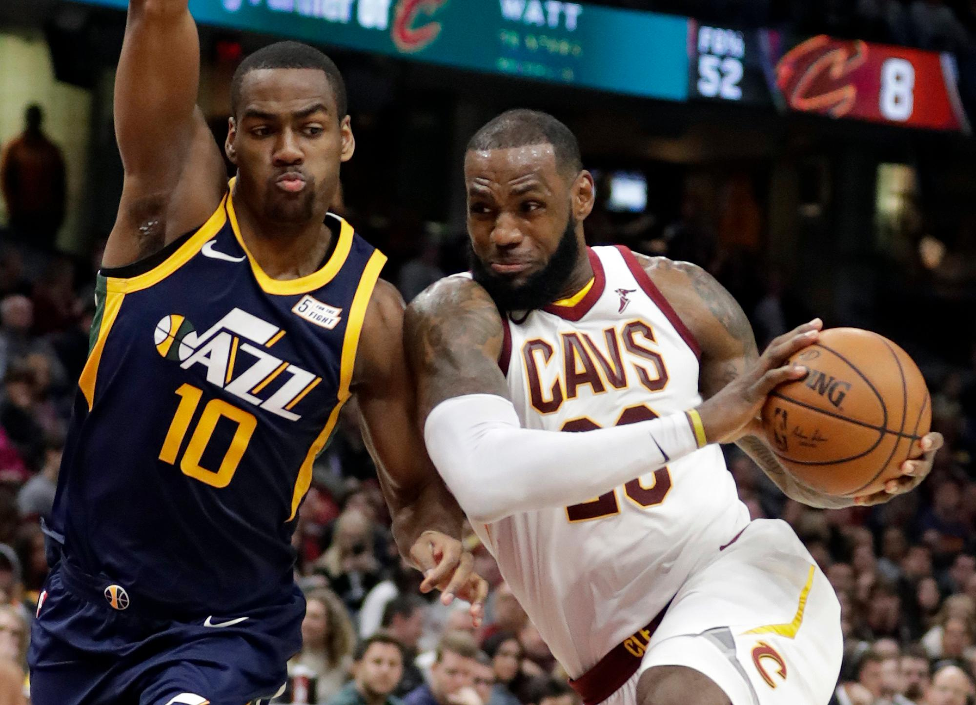 Cleveland Cavaliers' LeBron James, right, drives against Utah Jazz's Alec Burks (10) in the second half of an NBA basketball game, Saturday, Dec. 16, 2017, in Cleveland.(AP Photo/Tony Dejak)