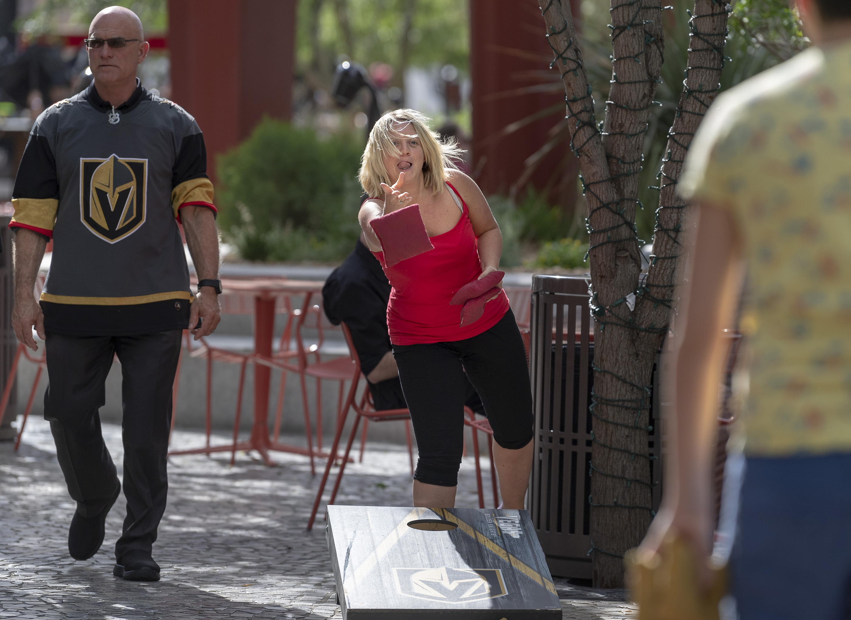 Visiting from England, Lisa Fletcher pitches the bean bag in the pre-game celebration in The Park  as the Vegas Golden Knights prepare to meet the Los Angeles Kings in the first quarterfinal game of the NHL Stanley Cup Playoffs at T-Mobile Arena in Las Vegas on Wednesday, April 11, 2018. Fletcher did not have tickets for the game.  CREDIT: Mark Damon/Las Vegas News Bureau