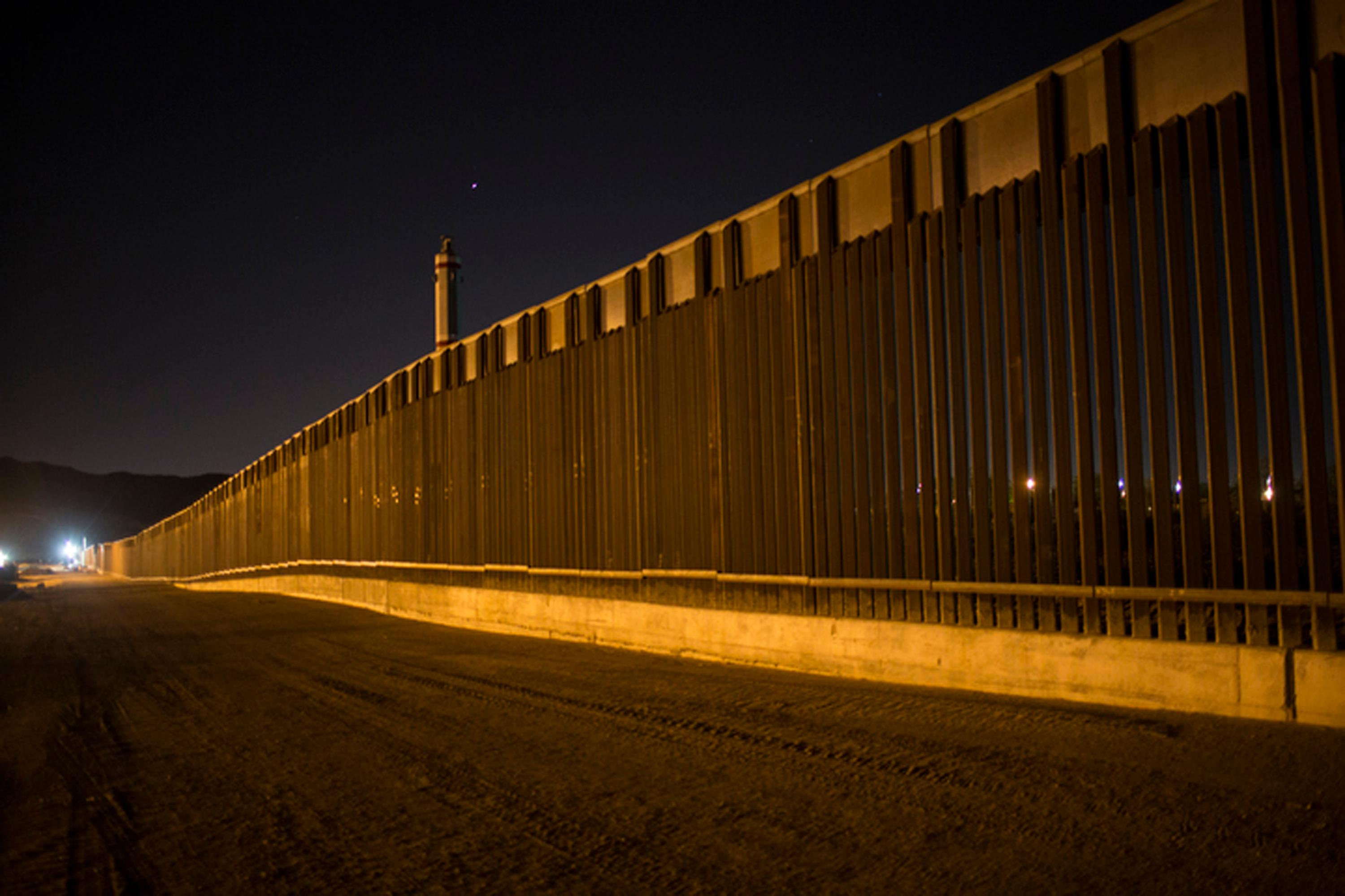 FILE - This March 30, 2017 file photo shows a portion of the new steel border fence that stretches along the US-Mexico border in Sunland Park, N.M. (AP Photo/Rodrigo Abd, File)<p></p>