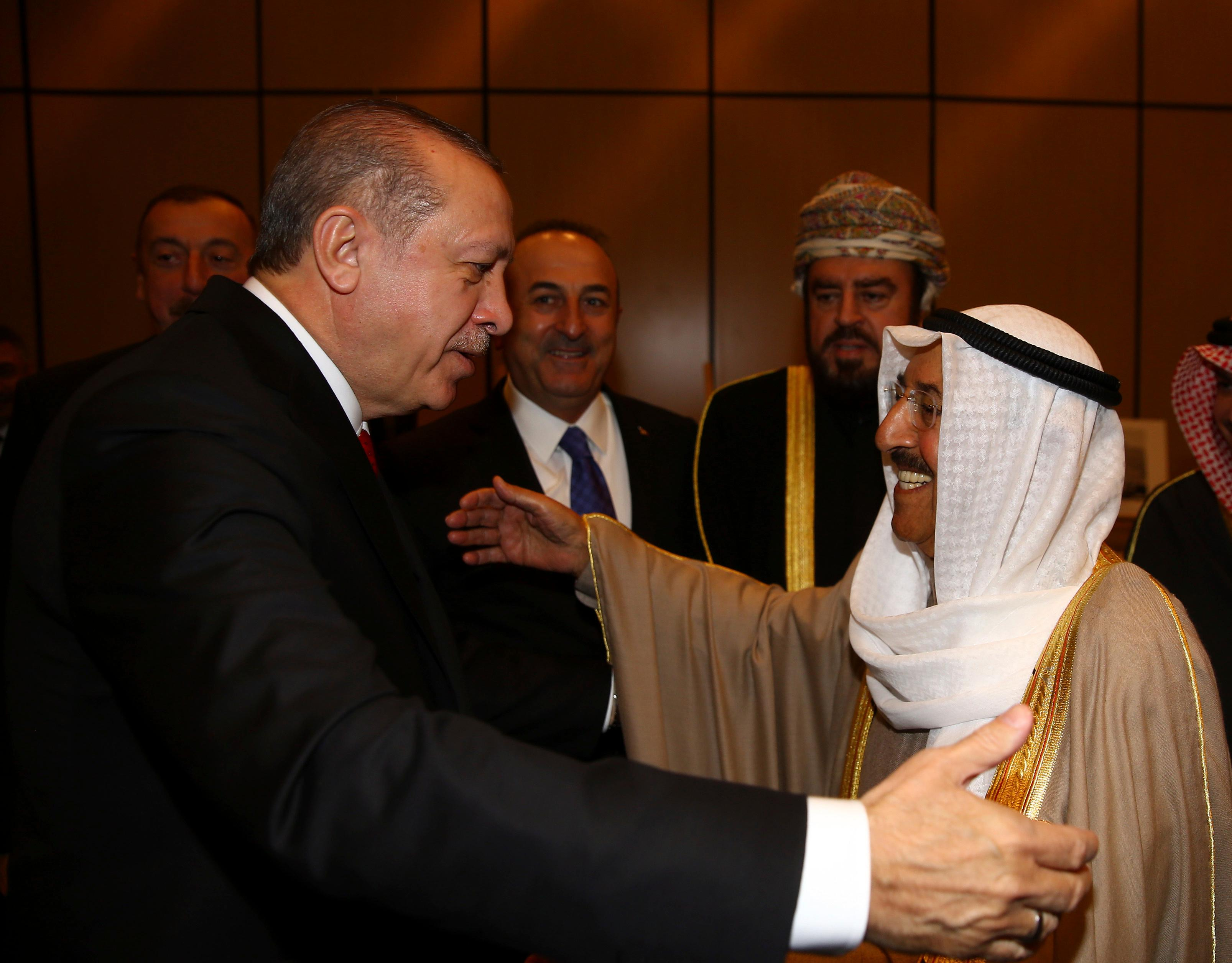 Turkey's President Recep Tayyip Erdogan, left, welcomes Kuwait's Emir Sheikh Sabah Al Ahmad Al Sabah, right, prior to the opening session of the Organisation of Islamic Cooperation Extraordinary Summit in Istanbul, Wednesday, Dec. 13, 2017. The Istanbul gathering of heads of state and top officials from the 57-member Organisation of Islamic Cooperation could offer the Muslim world's strongest response yet to U.S. President Donald Trump's recognition of Jerusalem as the capital of Israel.(Kayhan Ozer/Pool Photo via AP)