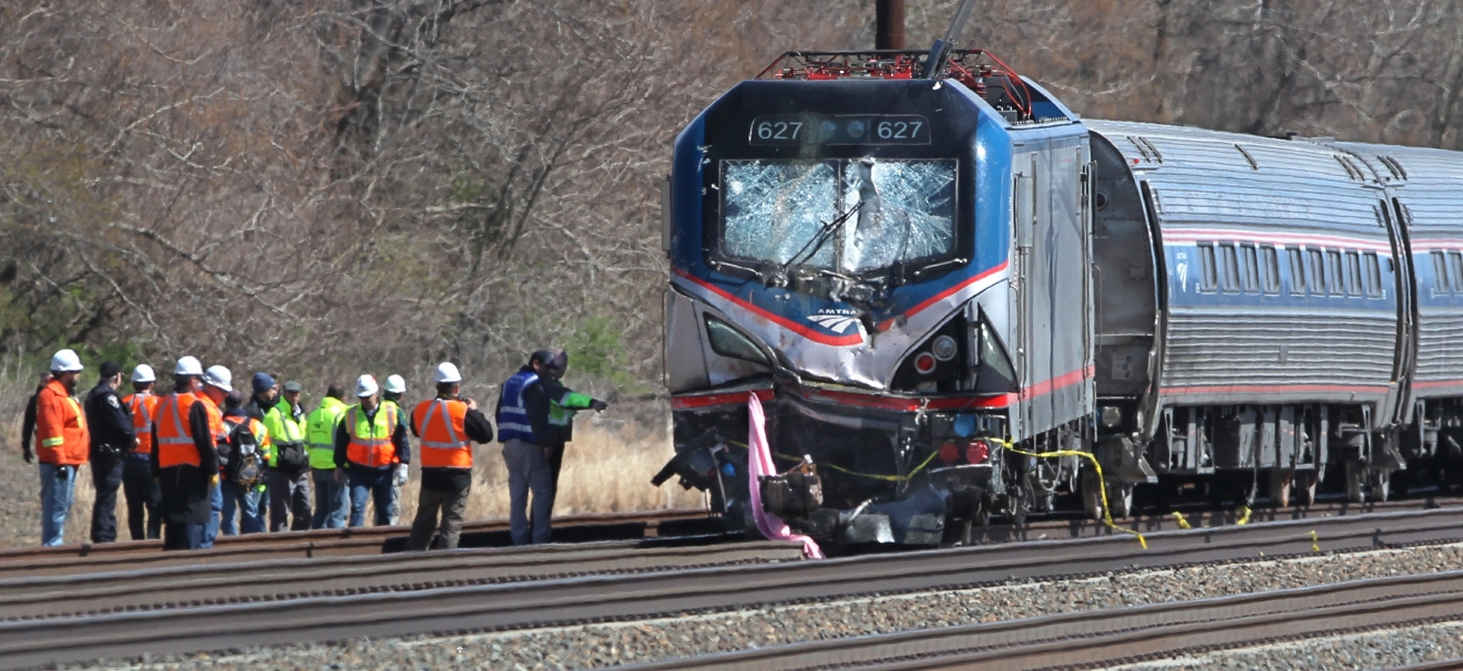 Amtrak investigators inspect the deadly train crash in Chester, Pa., Sunday, April 3 2016. The Amtrak train struck a piece of construction equipment just south of Philadelphia causing a derailment. (Michael Bryant/The Philadelphia Inquirer via AP)  PHIX OUT; TV OUT; MAGS OUT; NEWARK OUT; MANDATORY CREDIT