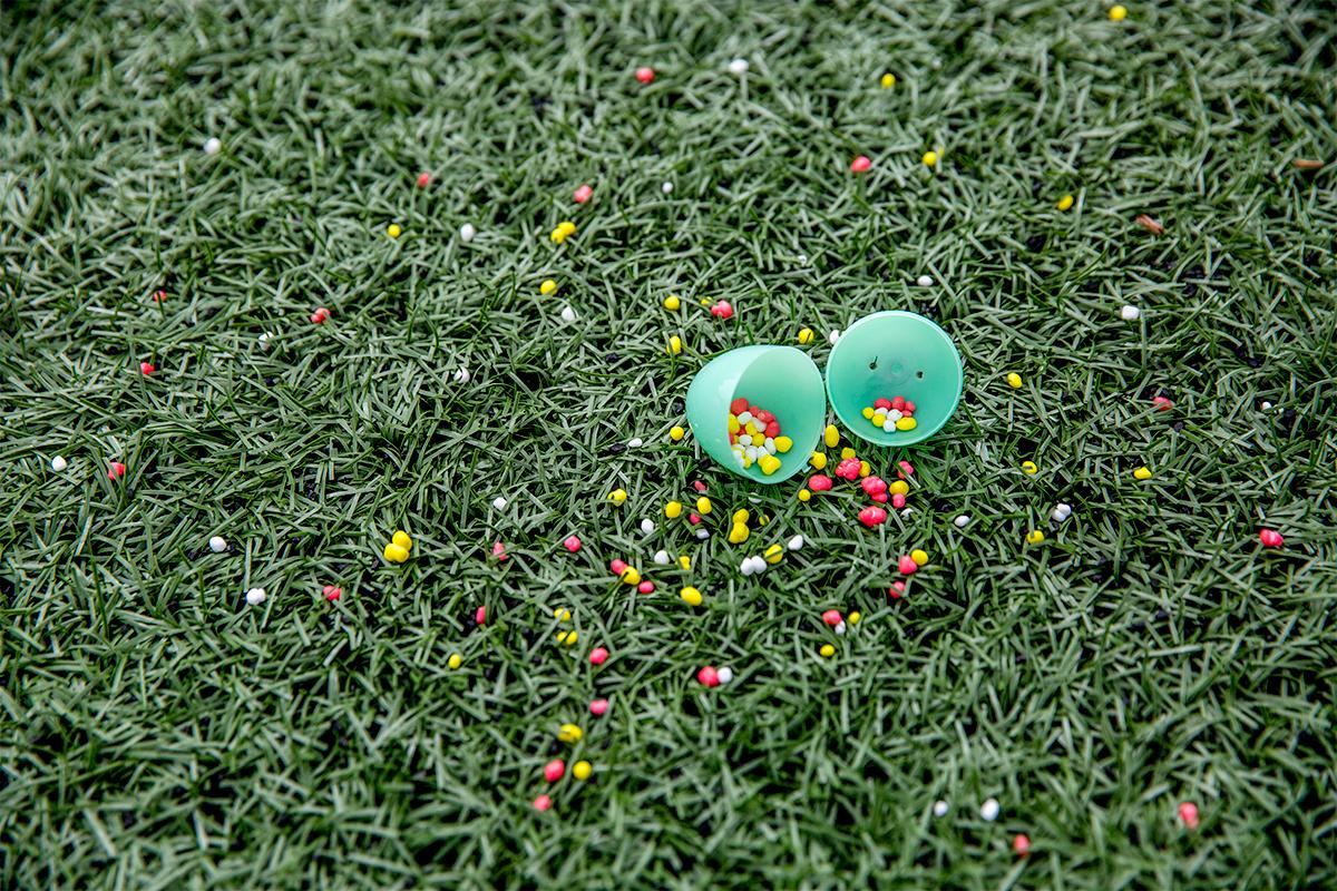 Despite some eggs cracking upon impact, the staff of Joy Church went around with spare eggs after the hunt to make sure every kid walked away with some candy. Hundreds of kids from young babies to school age converged on Marist High School on Saturday for a helicopter Easter egg drop. The event, put on by Joy Church, loaded up a large bucket with eggs then dropped it across the Marist football field by helicopter. Photo by August Frank, Oregon News Lab