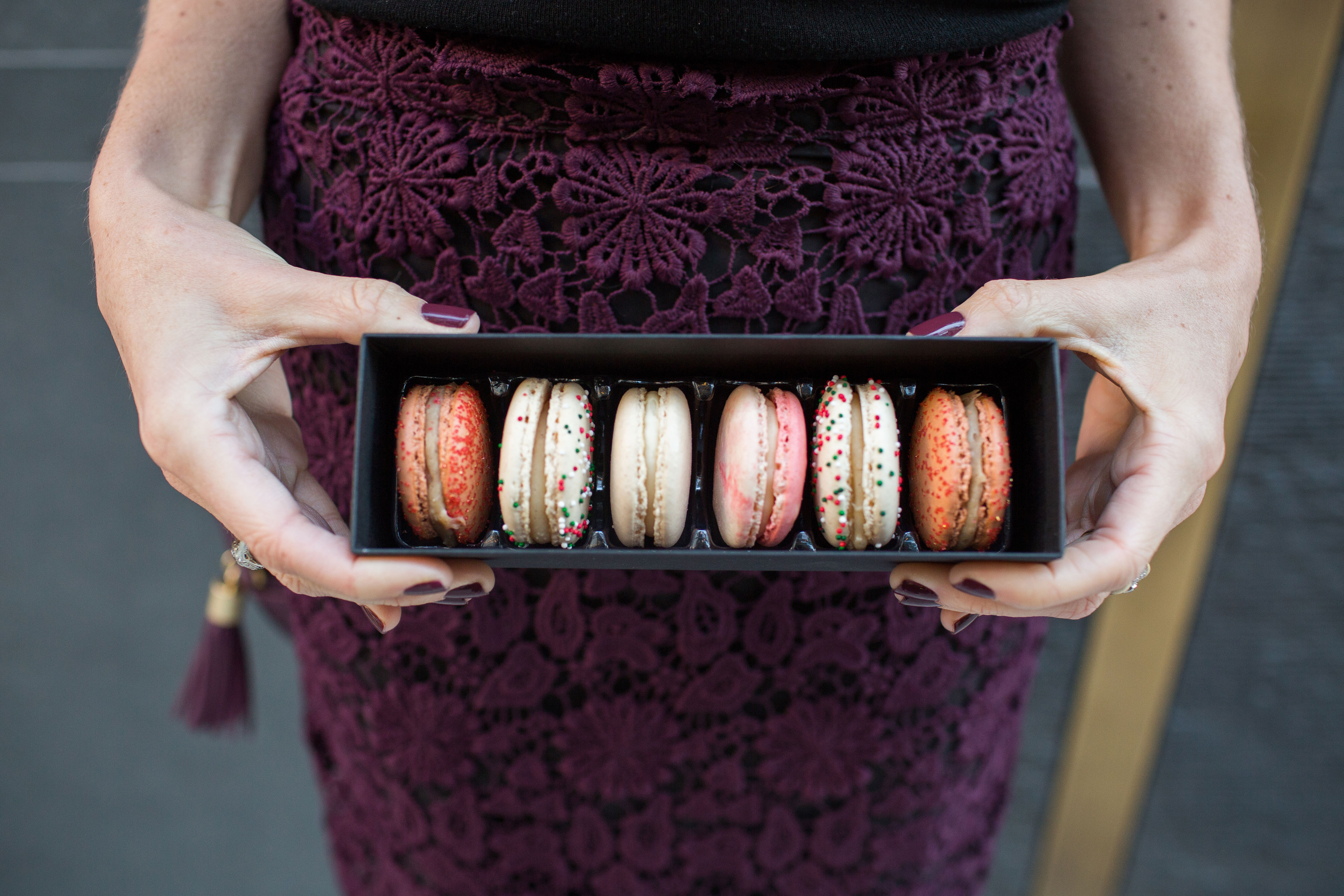 Compose a gift box featuring your pick of classic and holiday flavors – from blood orange and salted caramel to candy cane and eggnog. (Image: Courtesy Olivia Macaron)<p></p>