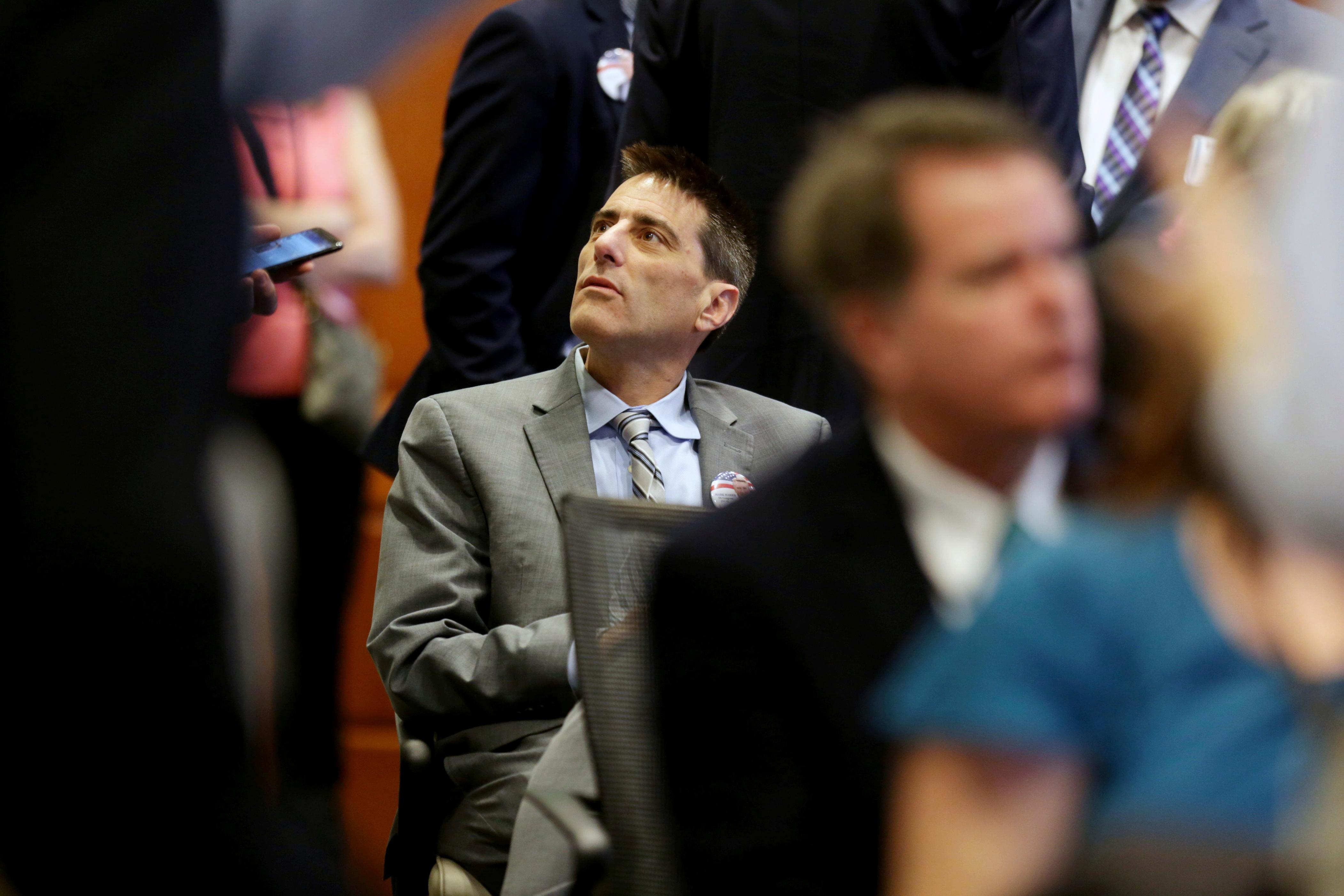 Executive director of the North Carolina Republican party Dallas Woodhouse is seated in the crowd during the public evidentiary hearing on the 9th Congressional District investigation Monday, Feb. 18, 2019, at the North Carolina State Bar in Raleigh, N.C. (Juli Leonard/The News & Observer via AP, Pool)