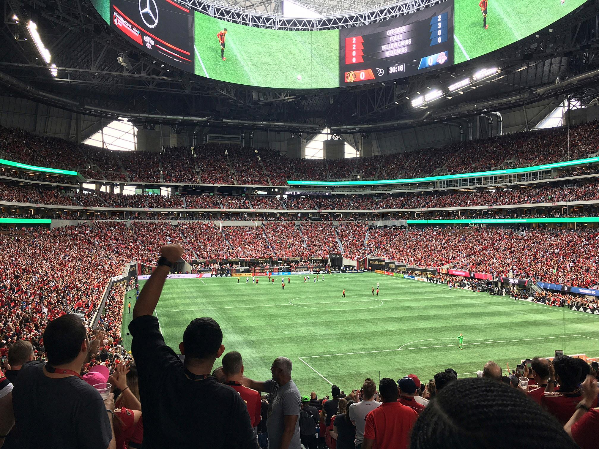 In this Oct. 22, 2017 photo, the crowd cheers as Atlanta United goal takes on Toronto FC in an MLS soccer match in Atlanta. Welcome to Atlanta, soccer's newest hotbed, which amazingly enough has sprouted up in a city known for its fickle sports fans and plenty of heartbreak from its teams.  (AP Photo/Paul Newberry)