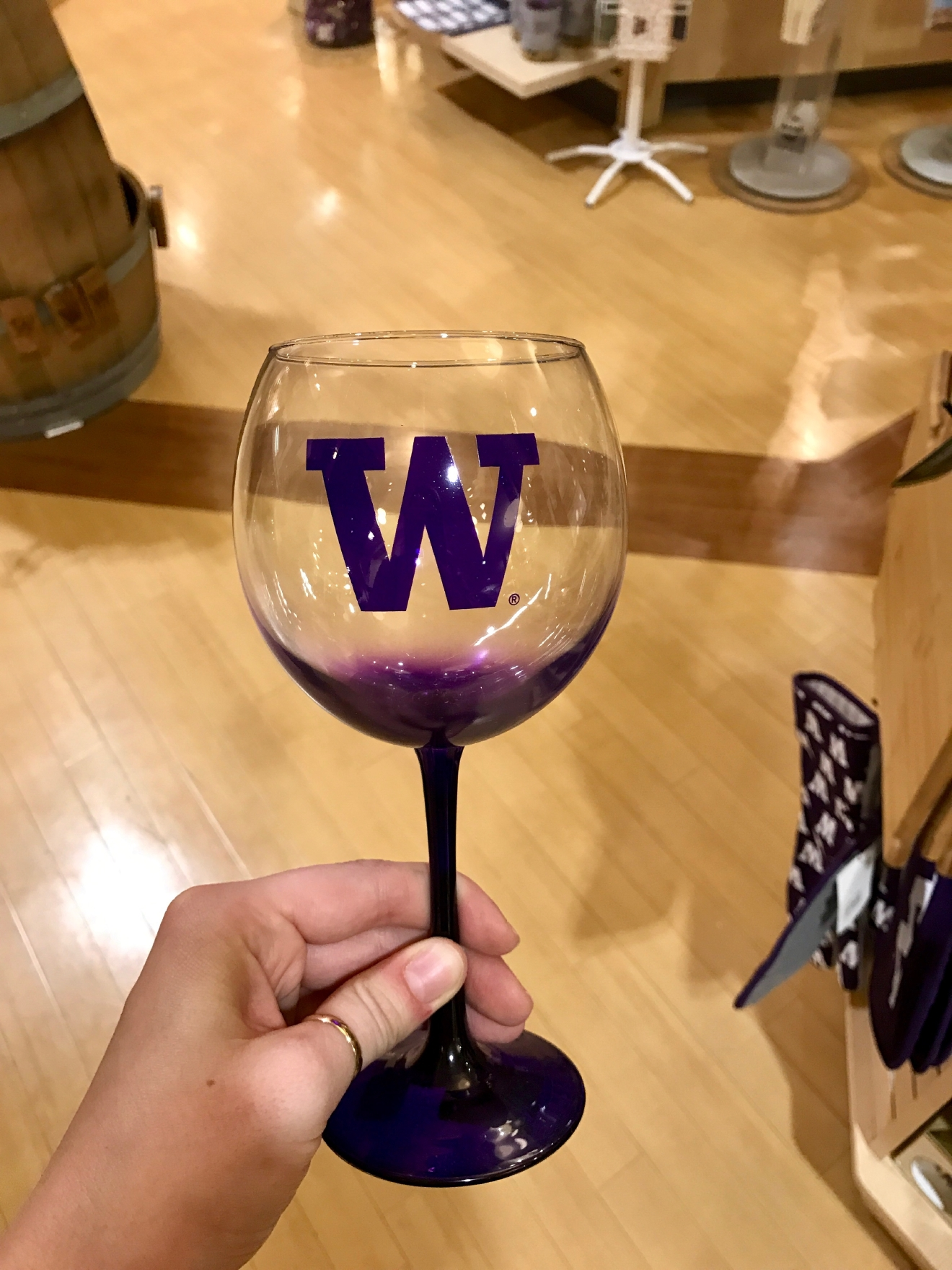 UW Wine Glass - $16.95                                          Whether you're a current student, alum, or just *love* the Dawgs, it's a pretty exciting time to be a Husky fan right now. Just to catch you up, the University of Washington football team is having one of their best seasons in years, and will be playing the Peach Bowl in Atlanta on December 31st. If you know a Dawg fan, they're probably salivating at the mouth right about now. Which is why it's a perfect time to give them a themed gift! Here are some of the coolest Husky gear we saw at the University Bookstore on the Avenue during our last visit. Pro Tip: They're open 10 a.m. - 7 p.m. on Christmas Eve! (Image: Britt Thorson / Seattle Refined)