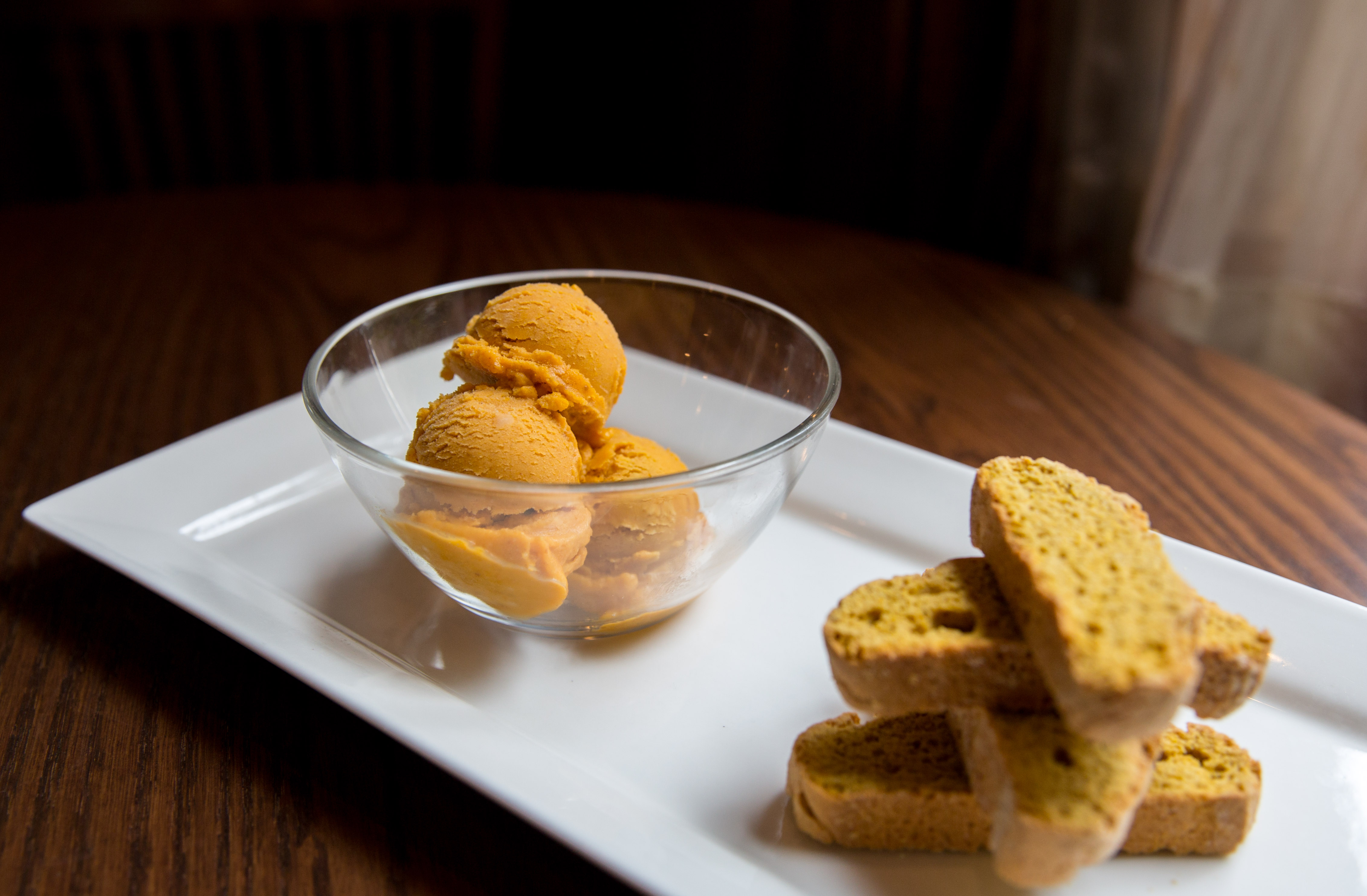 Pumpkin Gelato ($9), with pumpkin biscotti.{ } You can find these amazing pumpkin items at Tulio until October 31! (Image: Adela Lee).