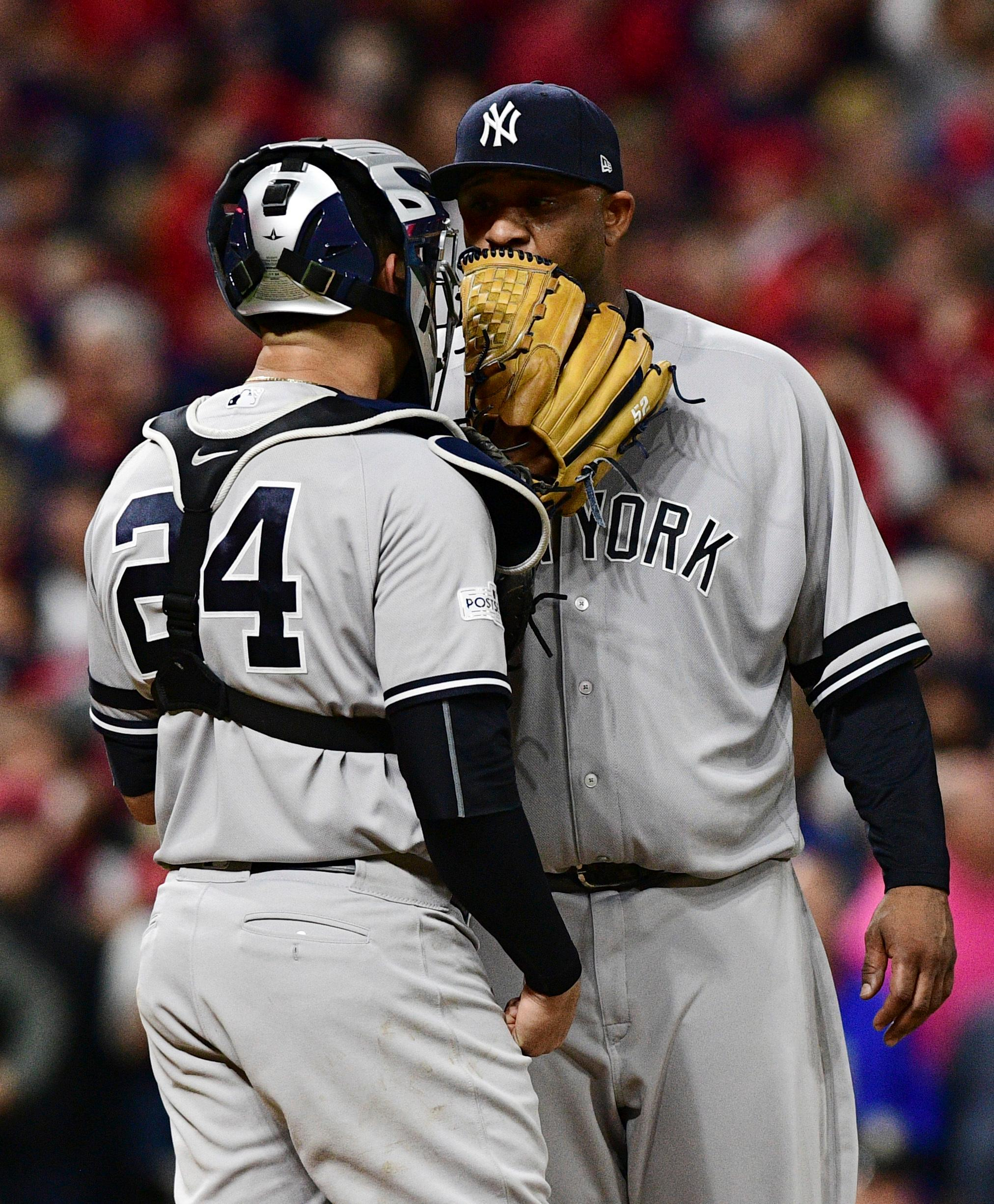 New York Yankees starting pitcher CC Sabathia, right, talks with catcher Gary Sanchez during the fifth inning of Game 5 of the team's baseball American League Division Series against the Cleveland Indians, Wednesday, Oct. 11, 2017, in Cleveland. (AP Photo/David Dermer)