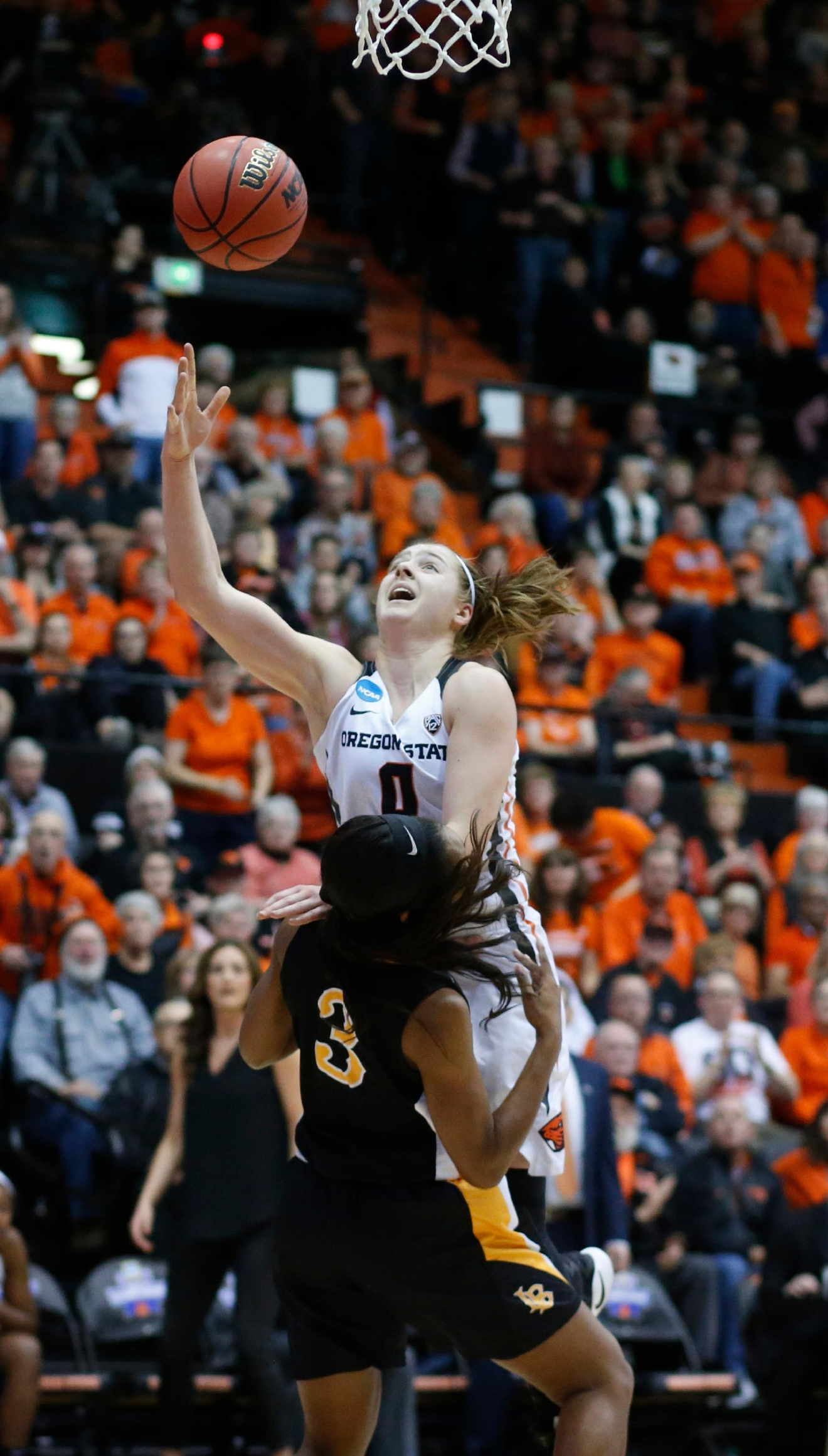 Oregon State's Mikayla Pivec (0) drives over Long Beach State's Chanterria Jackson (3) for a basket during the second half of a first-round game in the women's NCAA college basketball tournament Friday, March 17, 2017, in Corvallis, Ore. (AP Photo/ Timothy J. Gonzalez)