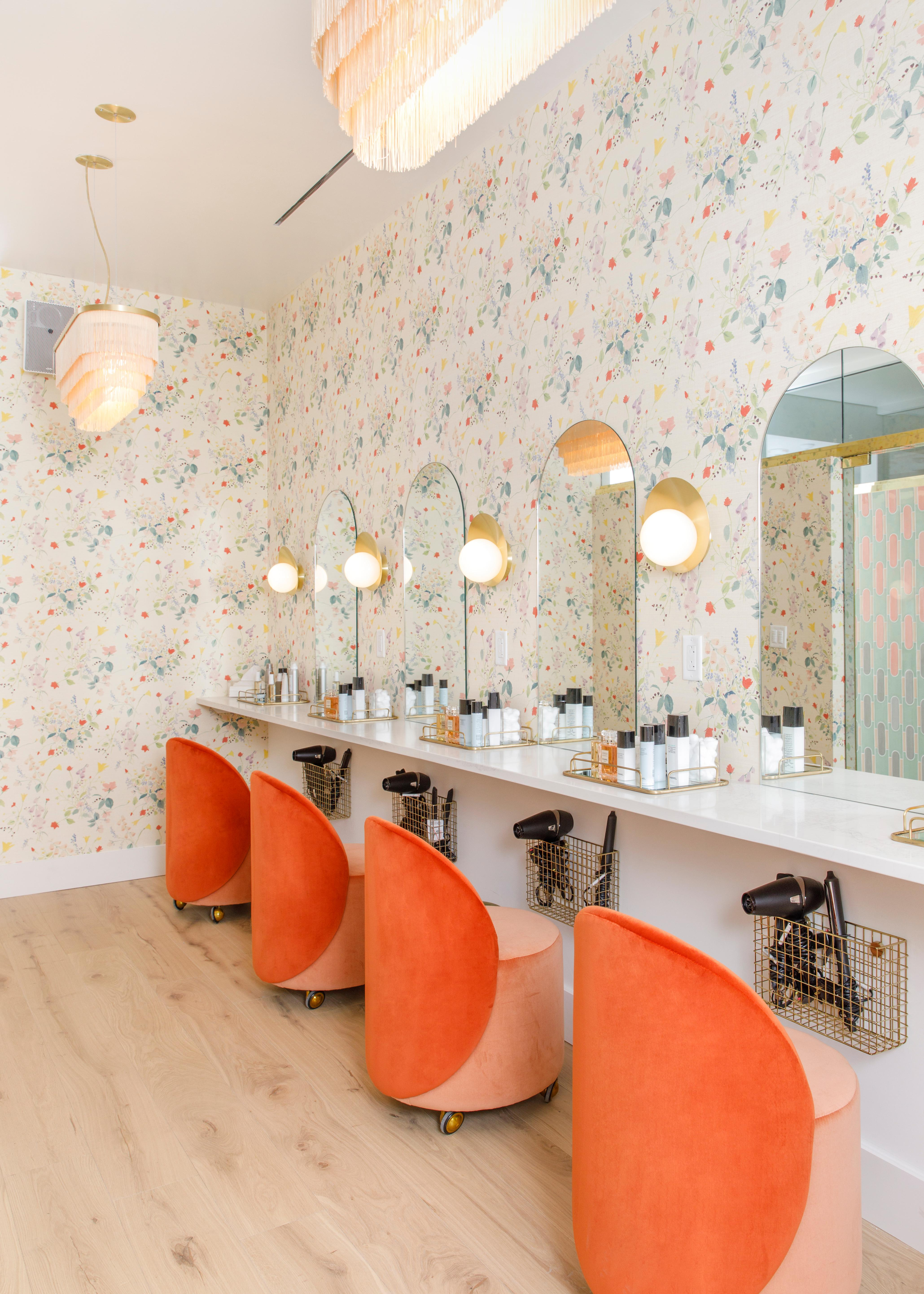 The beauty room is equipped with hair dryers, curlers, straighteners and free Chanel products -- The Wing regularly partners with Chanel for events and promotions. (Image: Courtesy The Wing)