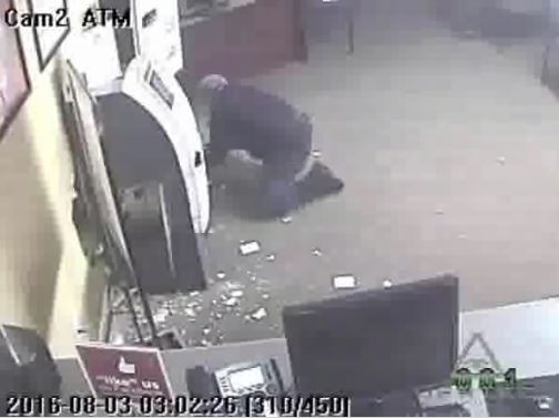 A man cut his way into the Fast Payday Loans in West Park.  Image Courtesy: Broward Sheriff's Office.