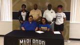 Four Marlboro County students sign college scholarships