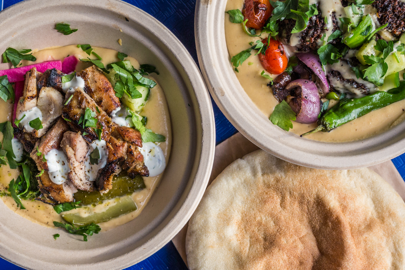 Grilled chicken and falafel, each served over hummus with veggies / Image: Catherine Viox // Published: 4.7.19