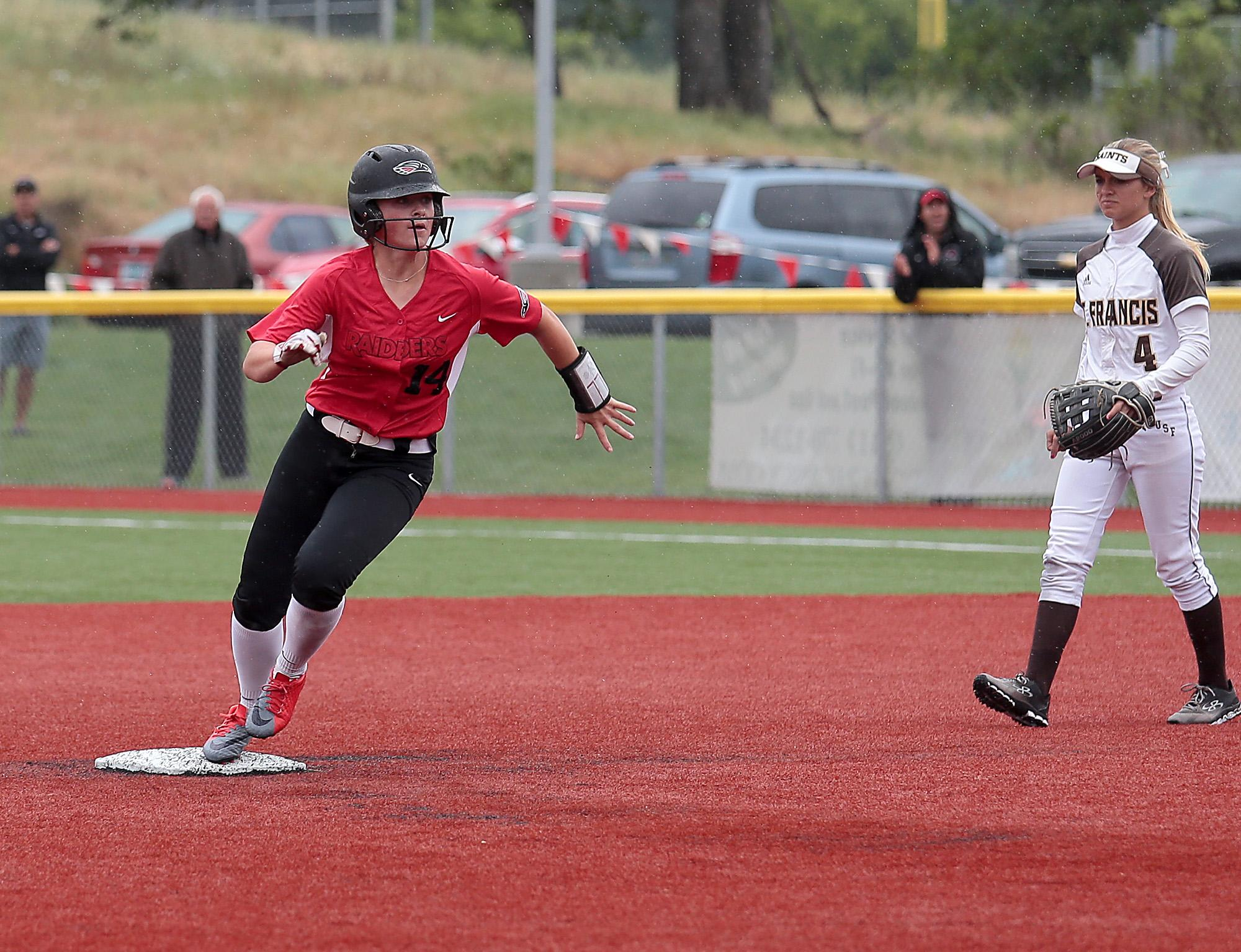 Southern Oregon University freshman Avery Morehead-Hutsell rounds second, as St. Francis infielder Brooke Karraker looks on, at US Cellular Community Park on Wednesday.[PHOTO BY:  LARRY STAUTH JR]