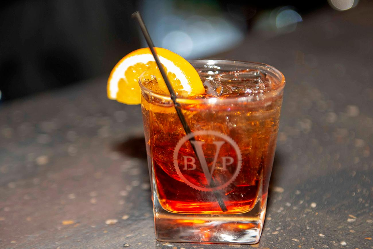 "Their signature cocktail. the Vecchio Moda, which means ""Old Fashion"" in Italian, is made with Elijah Craig Bourbon, fresh cherries and orange, a dash of Campari, and topped with soda.{ }/ Image: Joe Simon // Published: 3.10.19"