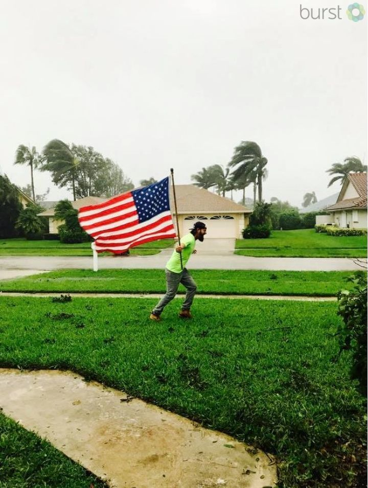 A Marine stands against the winds of Irma. / Photo Credit: Julie Michaels- Nickels